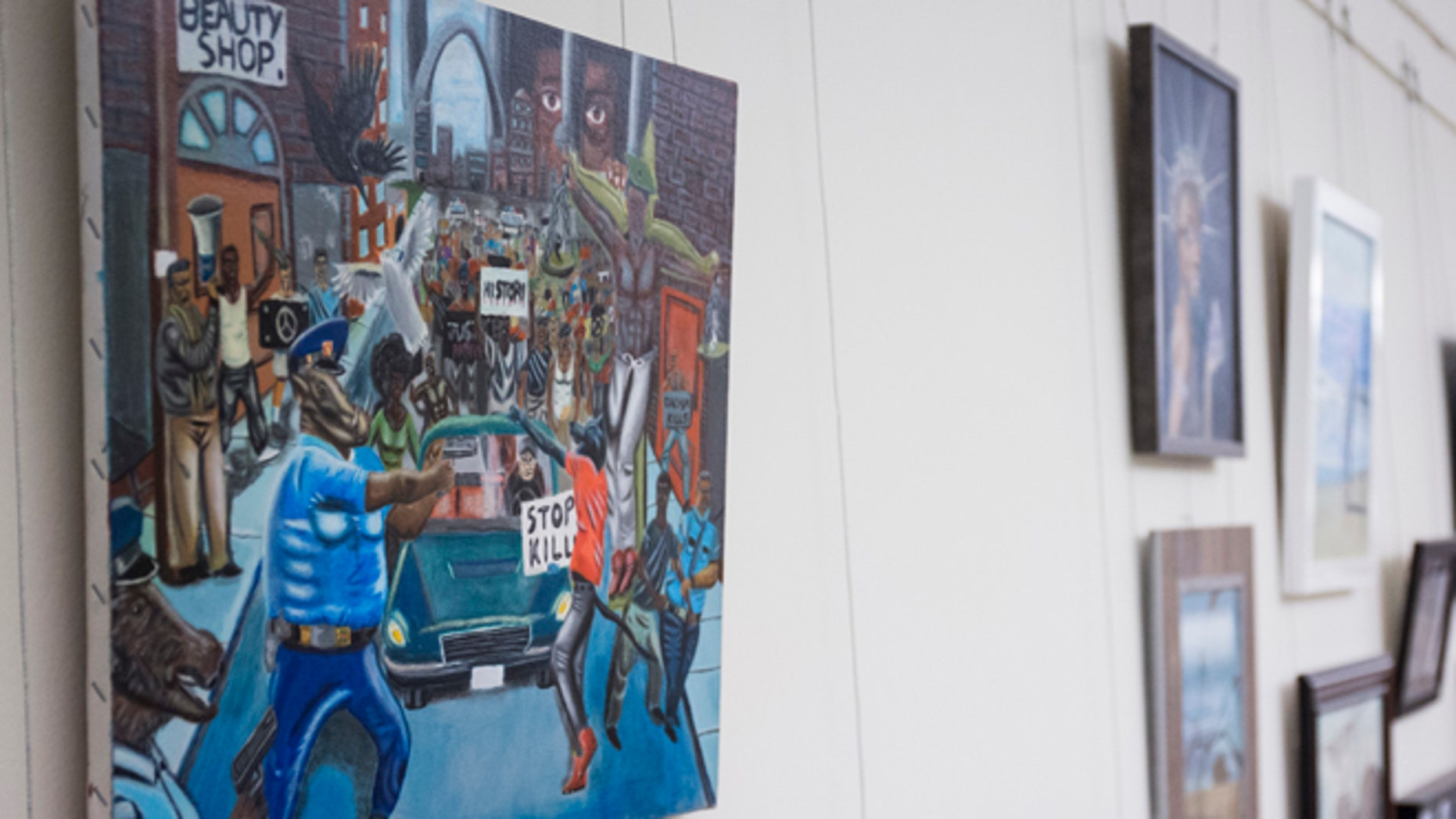 In this Jan. 5, 2017, photo, a painting by David Pulphus is shown hung in a hallway displaying paintings by high school students selected by their member of congress on Capitol Hill in Washington.