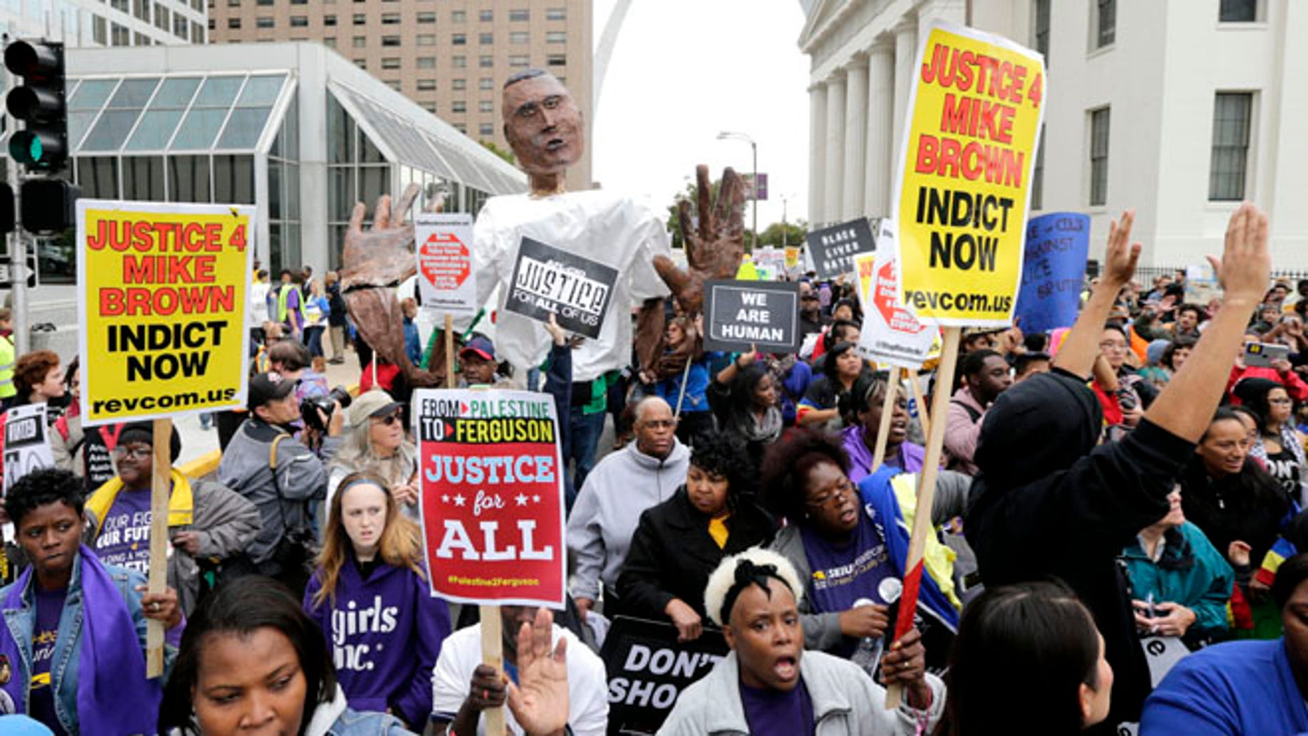 Oct. 11, 2014: Protesters march near the St. Louis Arch in St Louis. (AP)