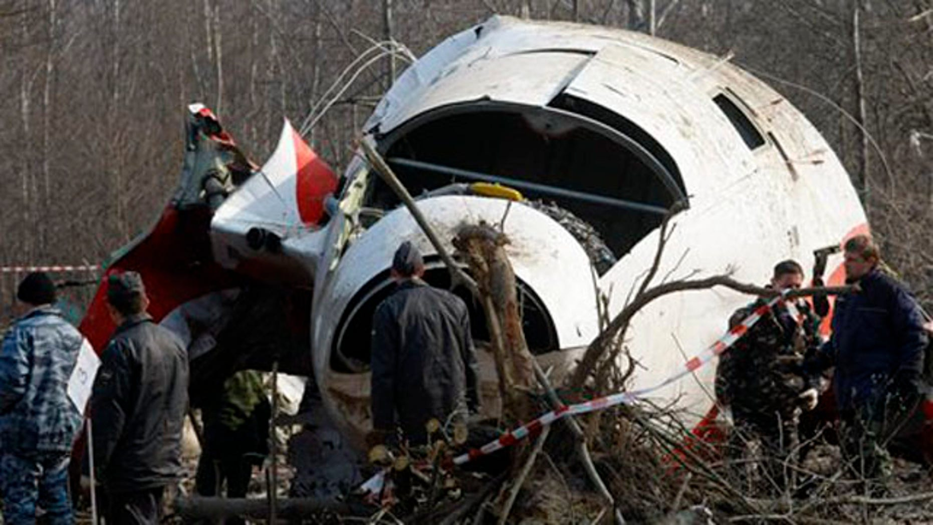 April 14, 2010: In this file picture emergency ministry workers prepare to load the wreckage of the Polish presidential plane onto a transporter just outside the Smolensk airport, western Russia.