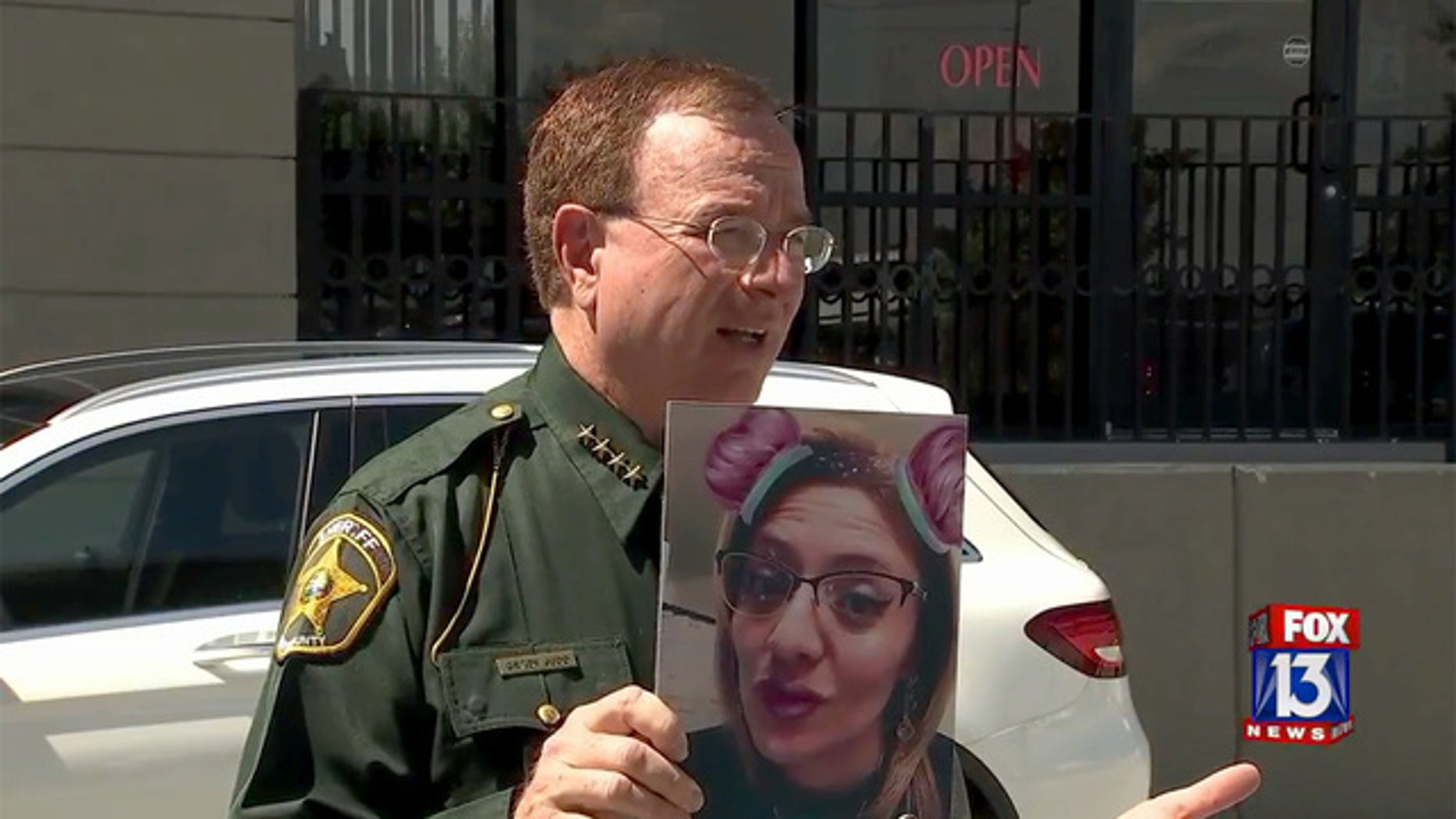 Polk County Sheriff Grady Judd, seen holding a photo of suspect Jesse Lopez, said she was operating without a medical license.