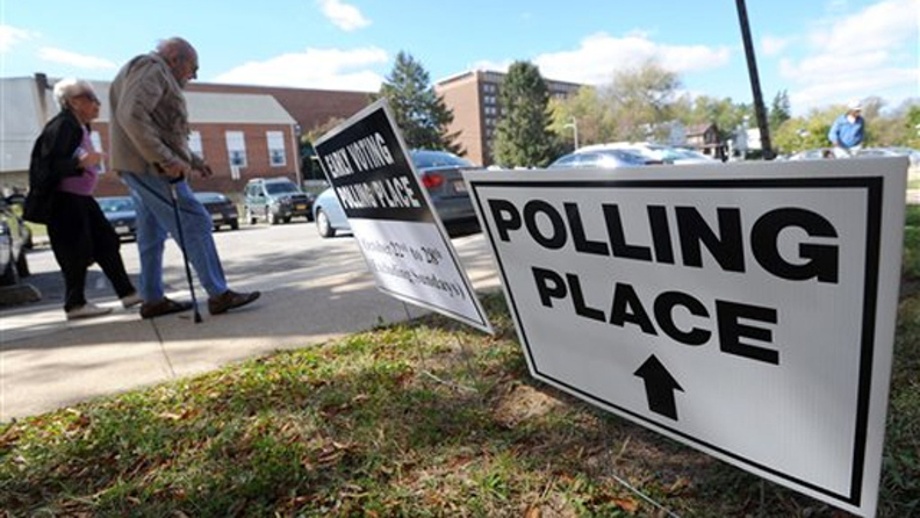 Voters arrive to cast early ballots in Maryland's general election Oct. 22 in Baltimore. (AP Photo)