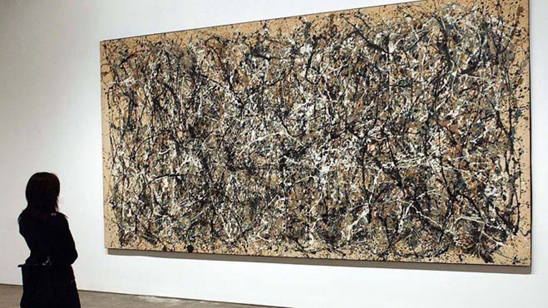 """FILE 2002: Jackson Pollock's painting """"One""""; is on display at the grand opening of the Museum of Modern Art (MoMA) in Queens, New York."""