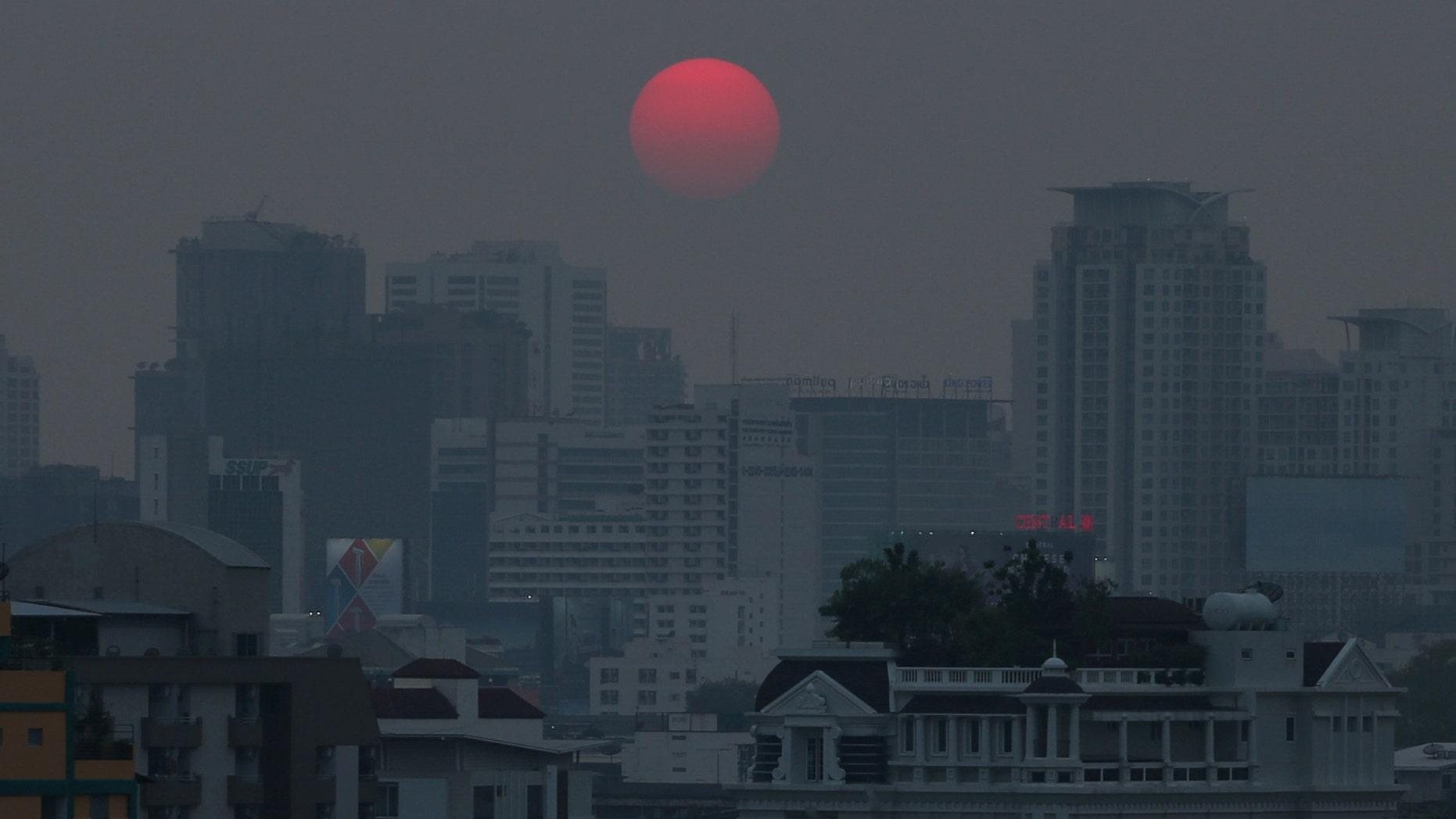 The sun is seen through evening air pollution in Bangkok, Thailand, Feb. 8, 2018.