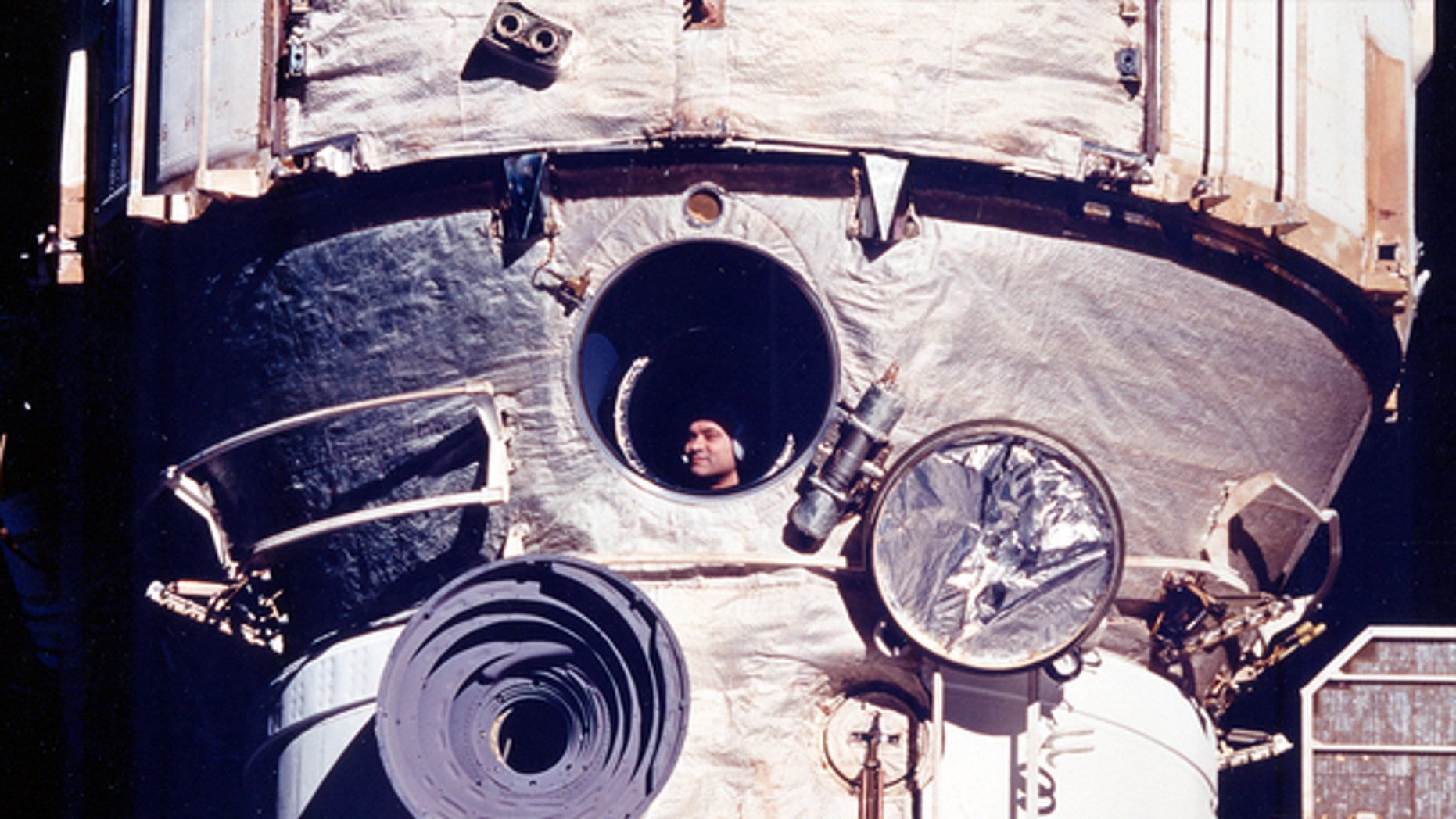 Cosmonaut Valery Polyakov looks out the Russian space station Mir's window during his record-setting 438-day mission from 1994 to 1995.