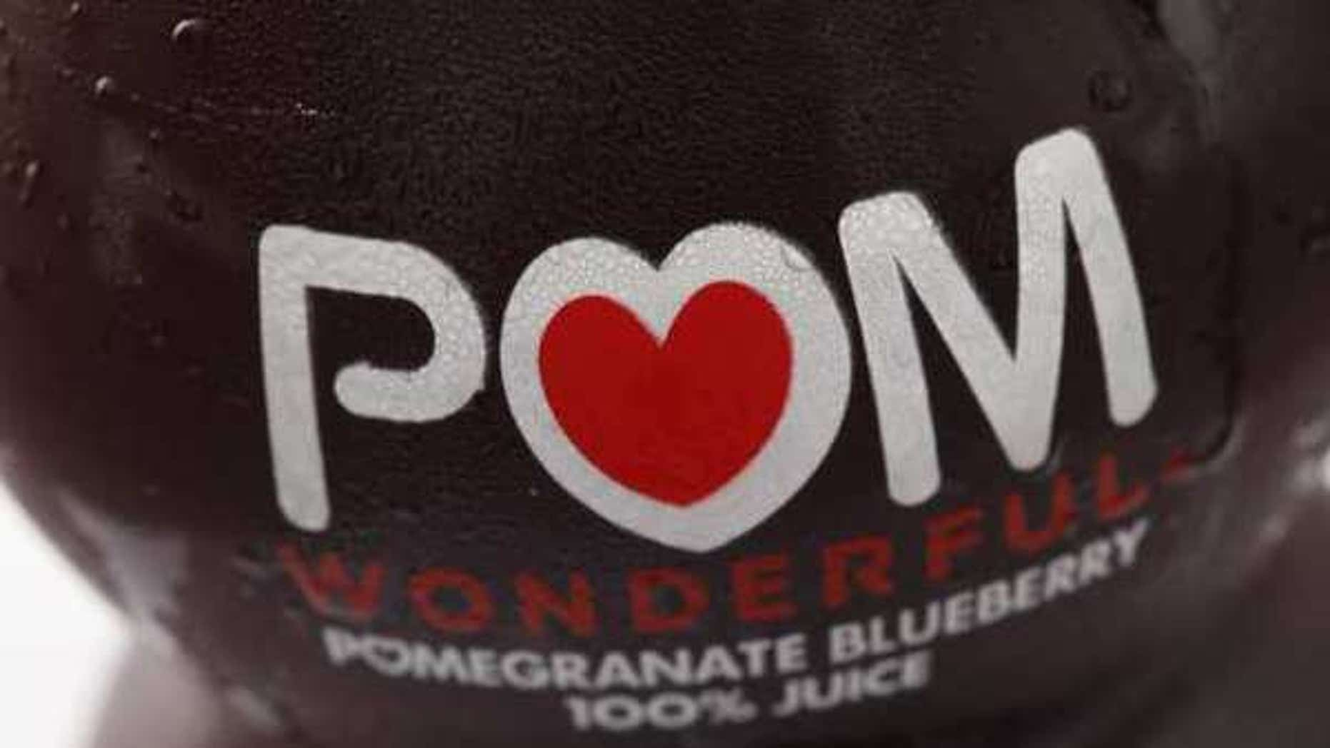 Displayed is a bottle of POM Wonderful juice in Philadelphia, Monday, Sept. 27, 2010. Regulators filed complaints against the makers of POM Wonderful Pomegranate Juice and other products on Monday, saying there's no science to support the company's claims that its products treat or prevent diseases such as prostate cancer and erectile dysfunction. (AP Photo/Matt Rourke)