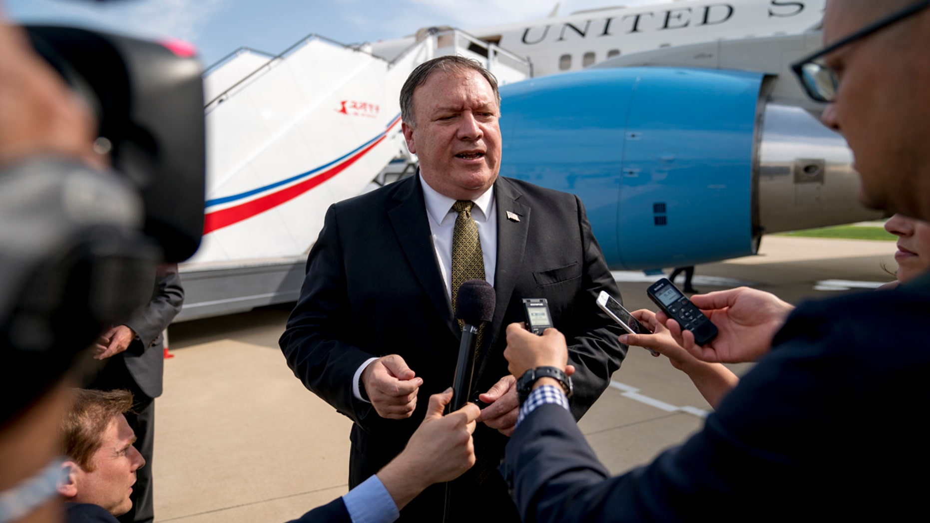 U.S. Secretary of State Mike Pompeo speaks to members of the media following two days of meetings with Kim Yong Chol, a North Korean senior ruling party official and former intelligence chief, before boarding his plane in Pyongyang, North Korea, Saturday, July 7, 2018, to Japan.