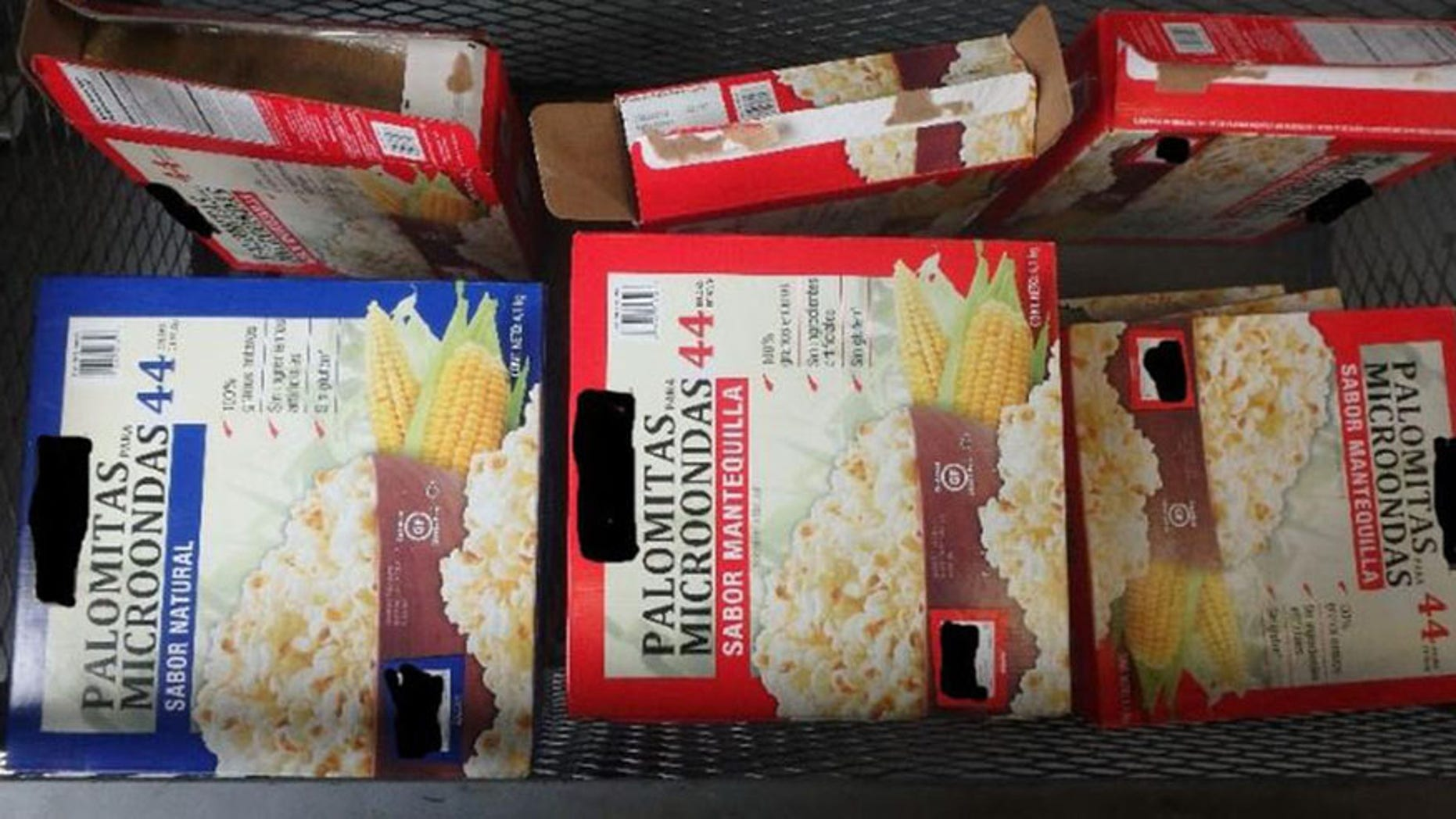 CBP officers found 15 packages of meth hidden inside boxes of popcorn.