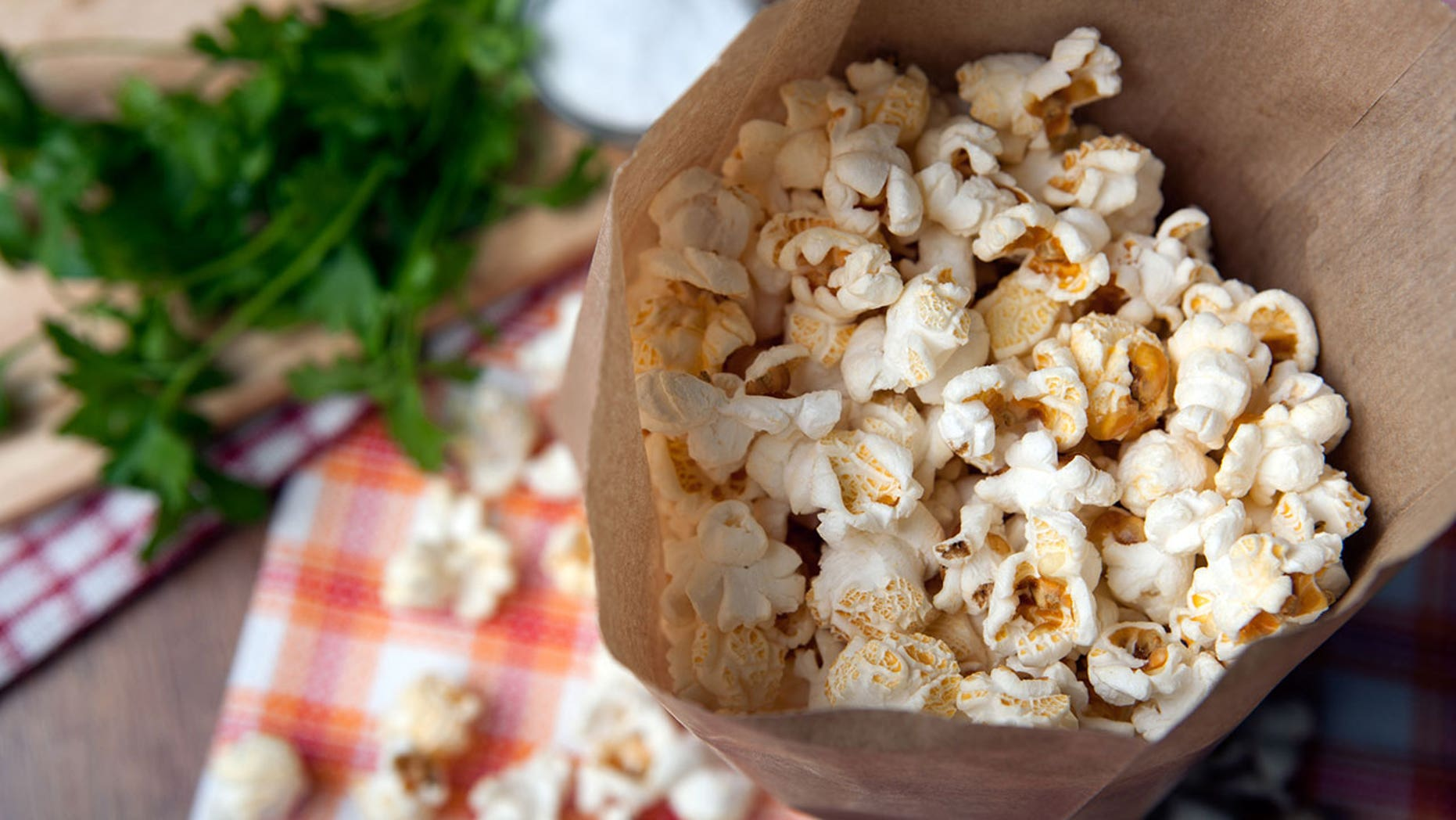 Looking for a more wholesome alternative for store-bought microwave popcorn? Just make your own in a paper bag.