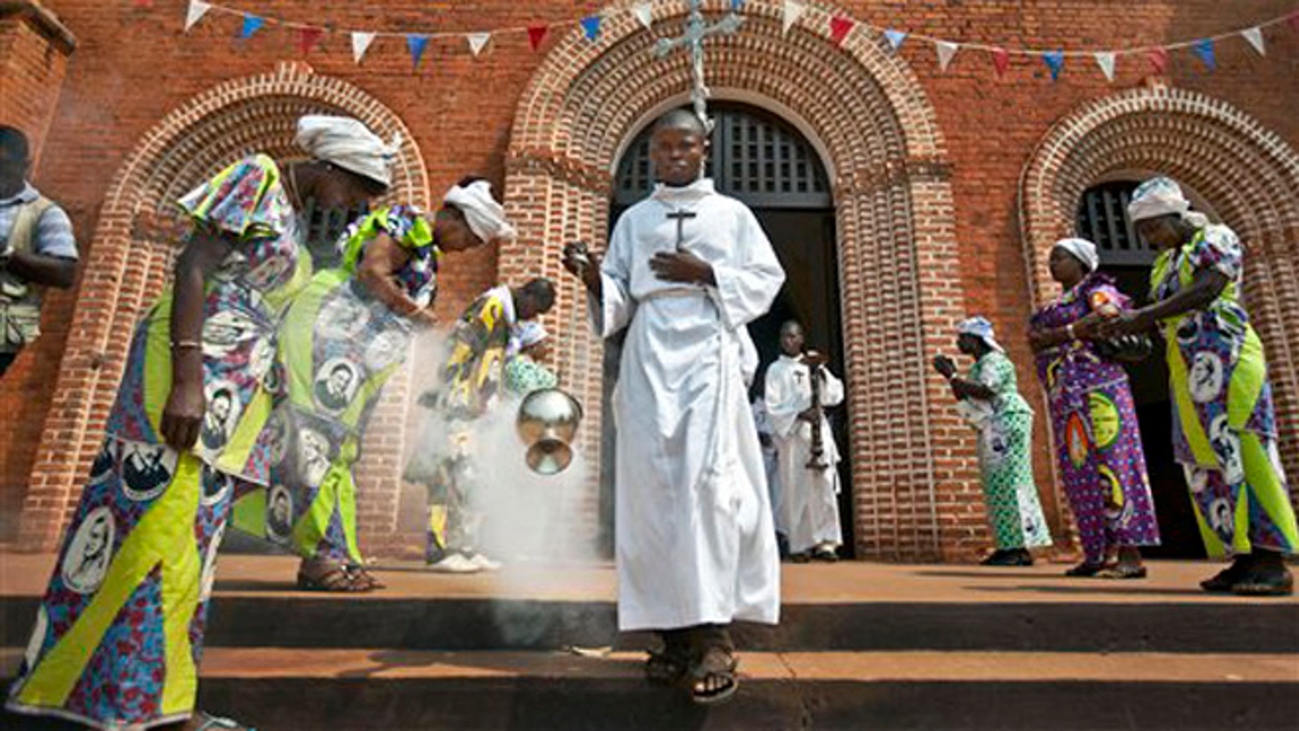 FILE - In this Sunday, Jan. 6, 2013 file photo, the thurifer swings the thurible of incense as he leads the procession out of the Notre Dame Cathedral of the Immaculate Conception at the end of the morning mass in Bangui, Central African Republic. Pope Francis follows his predecessors next week Nov. 25-30, 2015 to visit Africa whose growing numbers of Catholics are seen as a bulwark for a church seeking to broaden its appeal amid secularism, competing Christian faiths and violent extremism, in a trip that will take him to Kenya, Uganda and the Central African Republic. (AP Photo/Ben Curtis, File)
