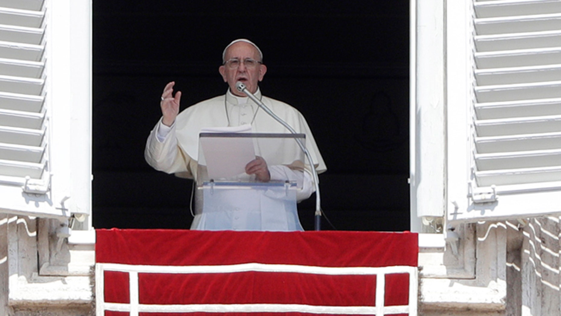 Pope Francis delivers his blessing as he recites the Angelus noon prayer in St. Peter's Square at the Vatican, Sunday, Sept. 3, 2017. (AP Photo/Gregorio Borgia)