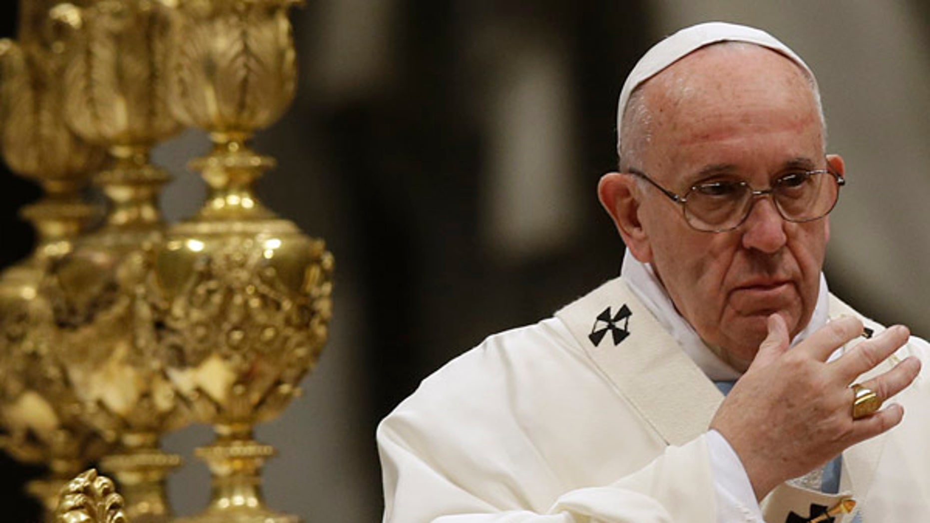 Jan. 1, 2016: Pope Francis makes the sign of the cross as he celebrates a New Year mass in St. Peter's Basilica at the Vatican. (AP)