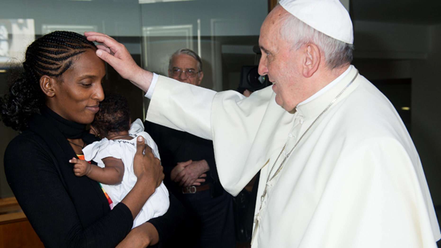 July 24, 2014: In this photo provided by the Vatican newspaper L'Osservatore Romano, Pope Francis meets Meriam Ibrahim, from Sudan, with her daughter Maya in her arms, in his Santa Marta residence, at the Vatican. The Sudanese woman who was sentenced to death in Sudan for refusing to recant her Christian faith has arrived in Italy along with her family, including the infant born in prison. (AP)