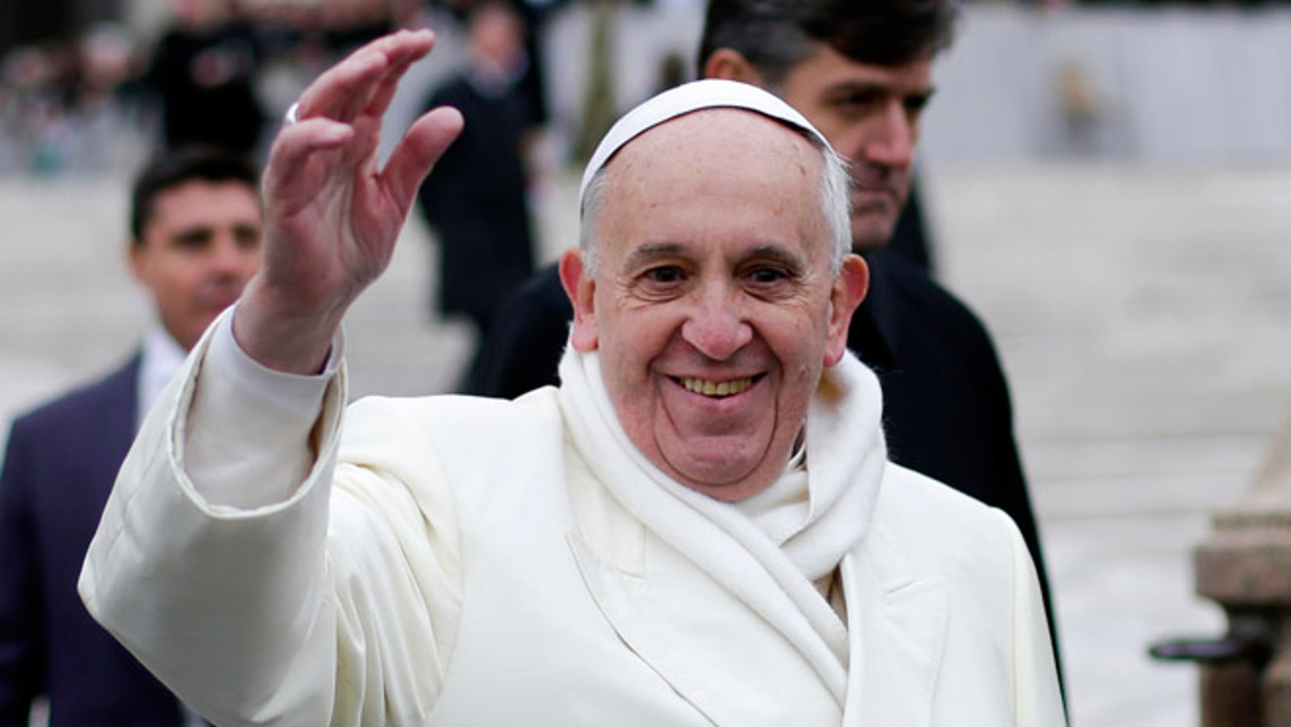 Nov. 27, 2013: Pope Francis waves as he conducts his weekly general audience at St. Peter's Square at the Vatican.