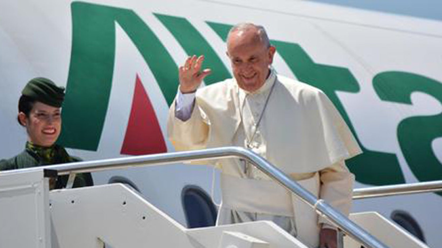 Pope Francis leaves for Poland with an Alitalia flight from the Fiumicino Airport in Rome, Wednesday, July 27, 2016. Pope Francis has departed for Krakow, where he will  join World Youth Day, a major gathering of Catholics. (Telenews/ANSA via AP Photo)