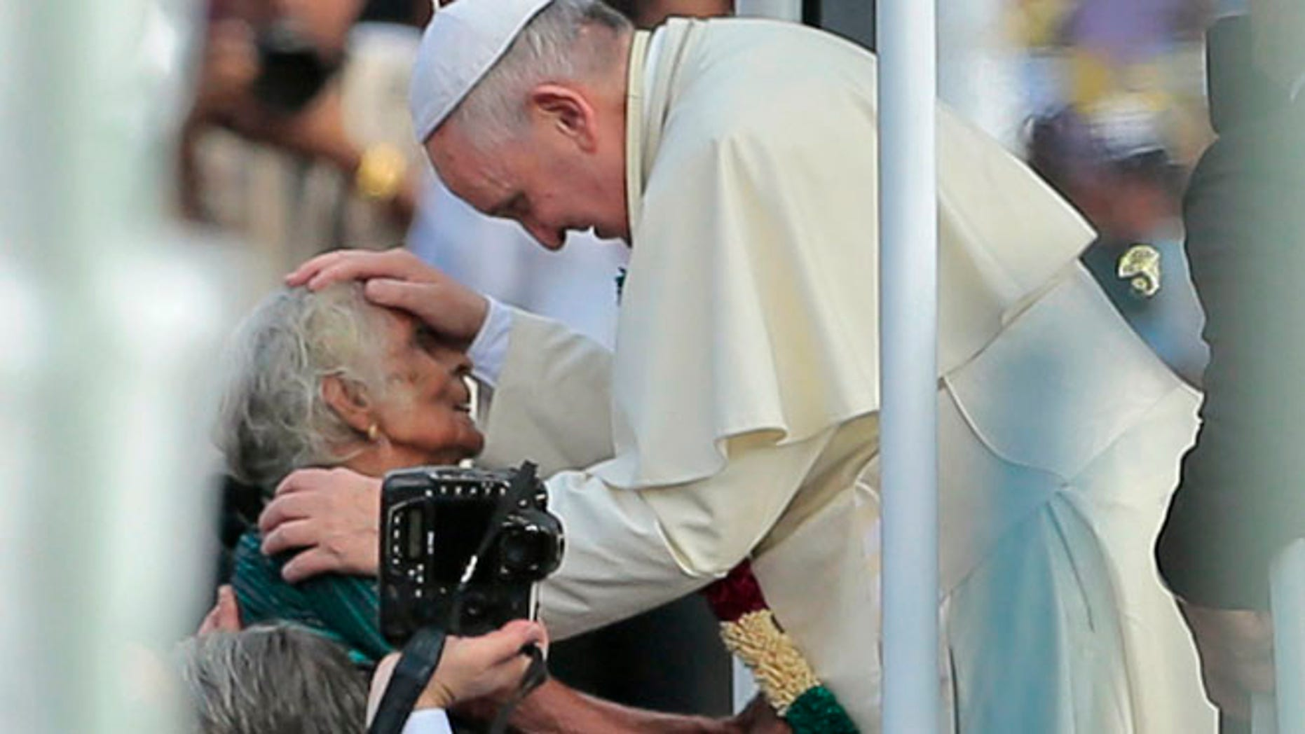 Jan. 14, 2015: Pope Francis reaches out to bless a Sri Lankan Catholic woman during his visit to the Church of Our Lady of Madhu in Madhu, Sri Lanka. (AP)
