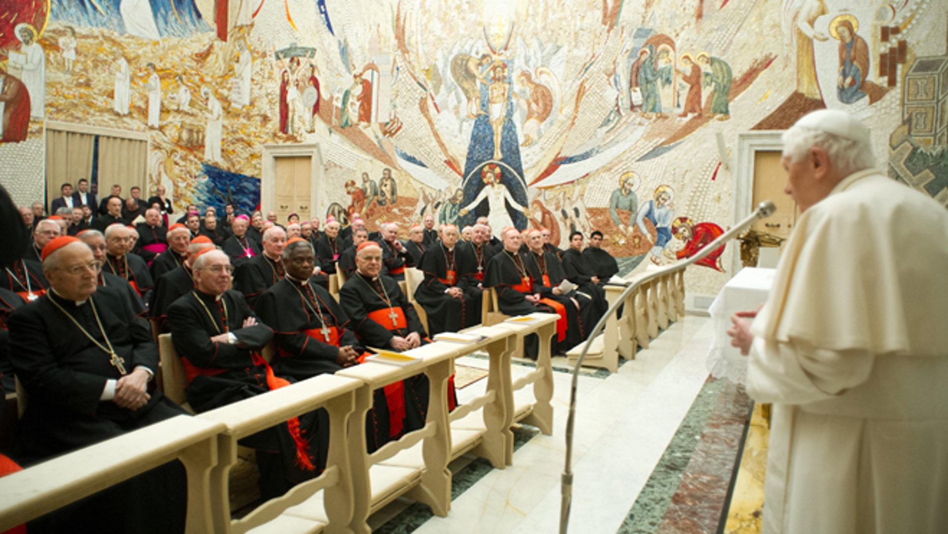 Feb. 23, 2013: In this photo provided by the Vatican newspaper L'Osservatore Romano, Pope Benedict XVI, right, delivers his message concluding a weeklong spiritual retreat, at the Vatican.