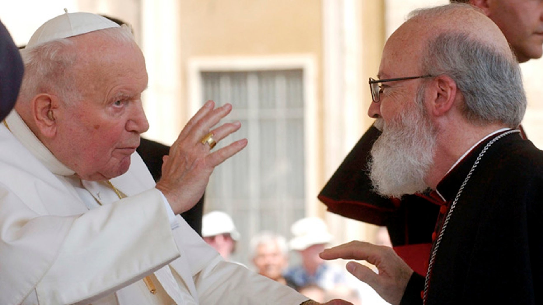 """In this June 30, 2004, file photo, Pope John Paul II blesses Msgr. Sean Patrick O'Malley, Archbishop of Boston, during the weekly open-air general audience in St. Peter's square at the Vatican.  Among the eight cardinals Pope Francis chose as his new """"kitchen cabinet,"""" only one is from North America: Boston Cardinal Sean O'Malley. The panel of cardinals has planned to meet at the Vatican for the first time Oct. 1, 2013."""