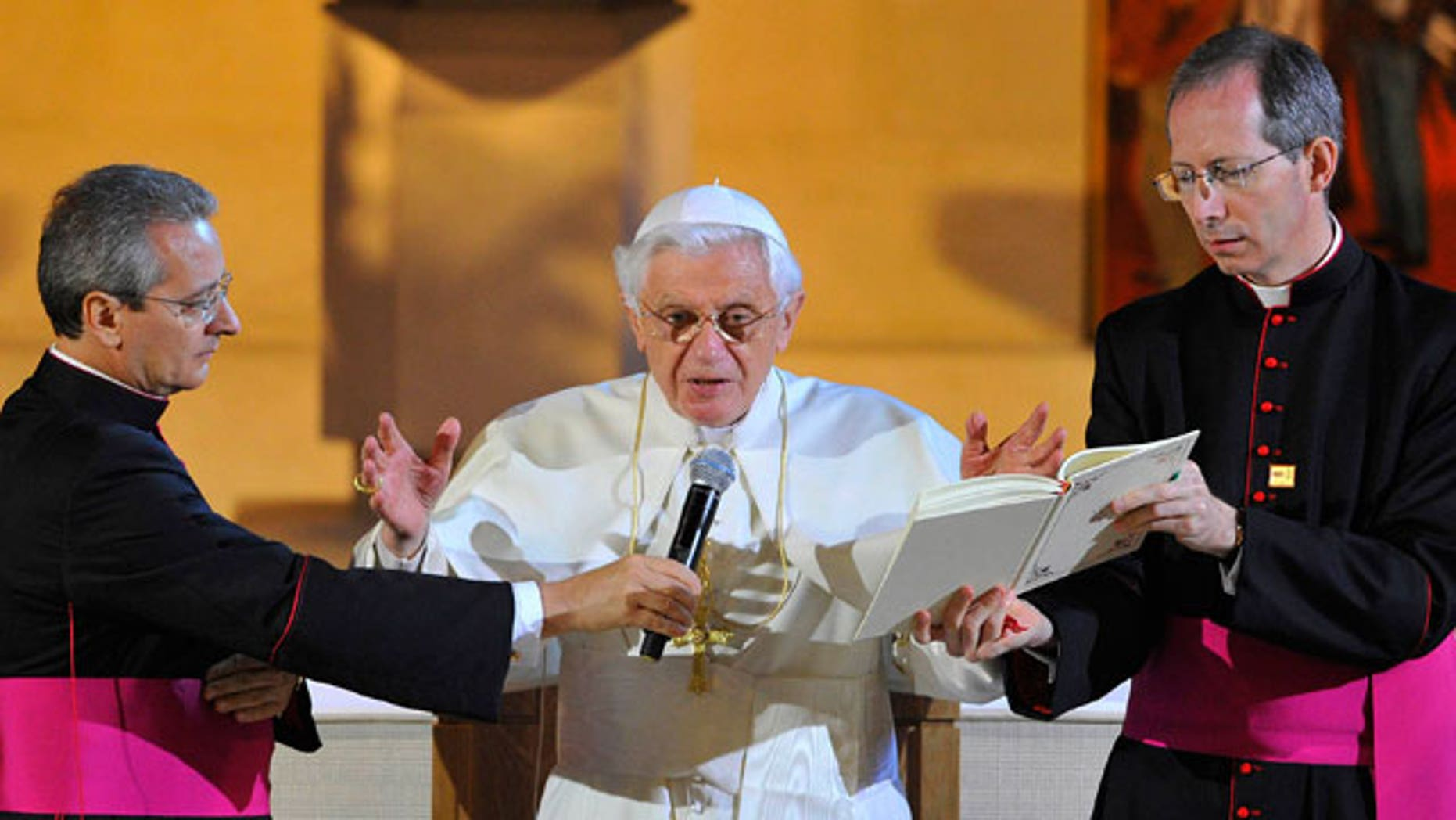 Pope Benedict XVI, right, attends a Service of Prayer at St Mary's University College Chapel at Twickenham, London Friday Sept. 17, 2010. Thousands of cheering Catholic schoolchildren feted Pope Benedict XVI on his second day in Britain on Friday, offering a boisterous welcome even as the pontiff urged their teachers to make sure to provide a trusting, safe environment.
