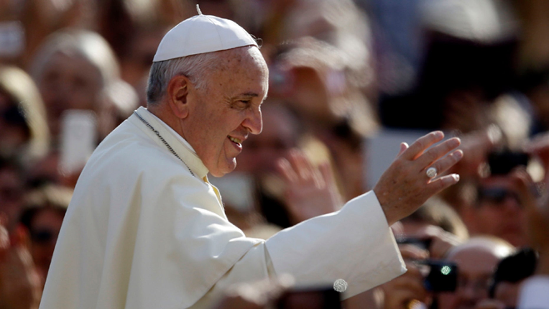 Oct. 1, 2014: Pope Francis blesses faithful upon his arrival for the weekly general audience in St. Peter's Square at the Vatican. (AP)