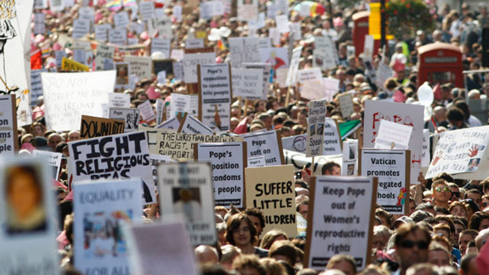 Thousands of people march through central London to protest against the State visit of Pope Benedict XVI to Britain, Saturday, Sept. 18, 2010. Pope Benedict XVI is on a four-day visit, the first-ever state visit by a Pope to Britain.