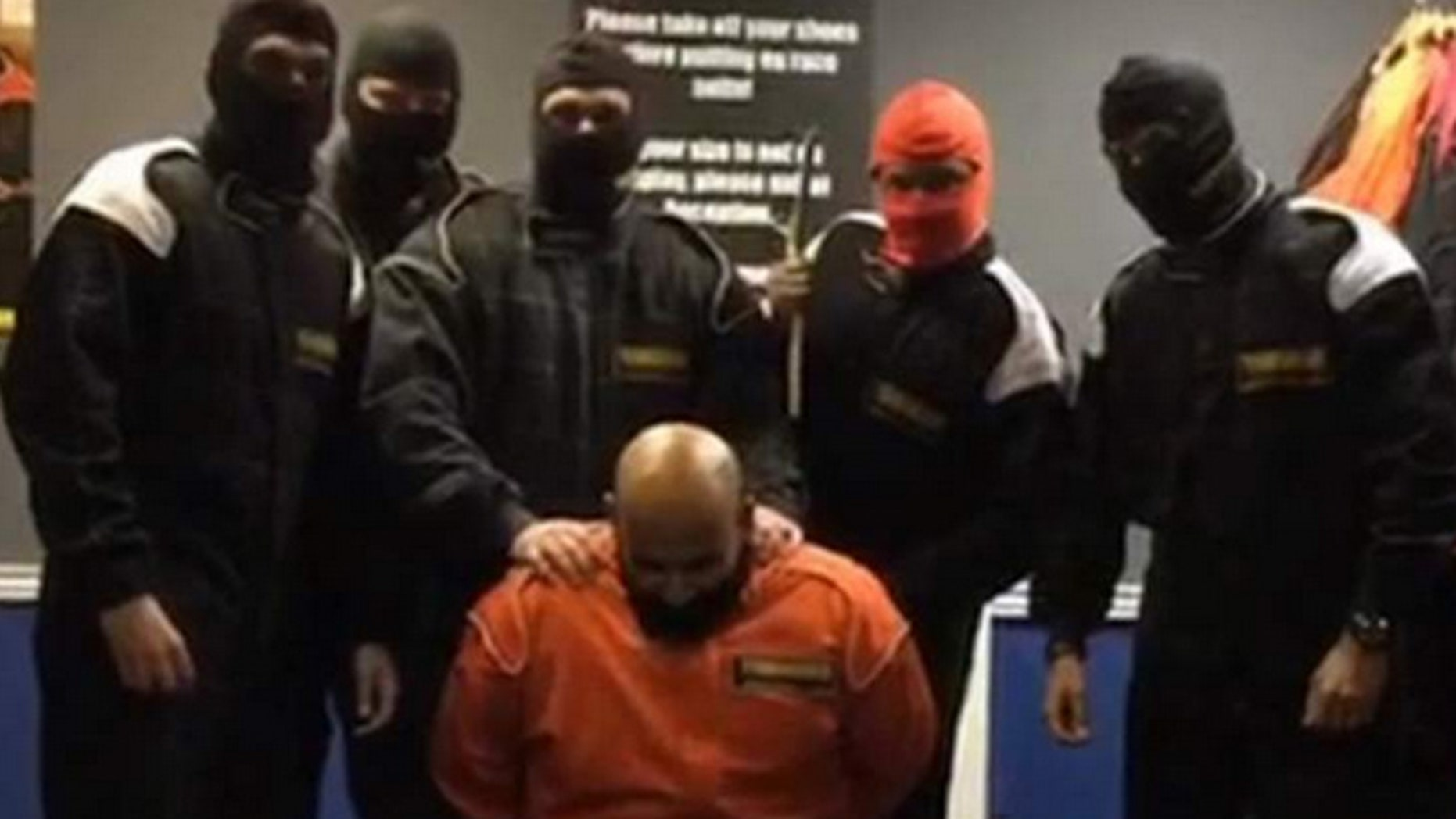 Six staff from HSBC were fired after a video appeared online showing them taking part in a mock Islamic State style killing.