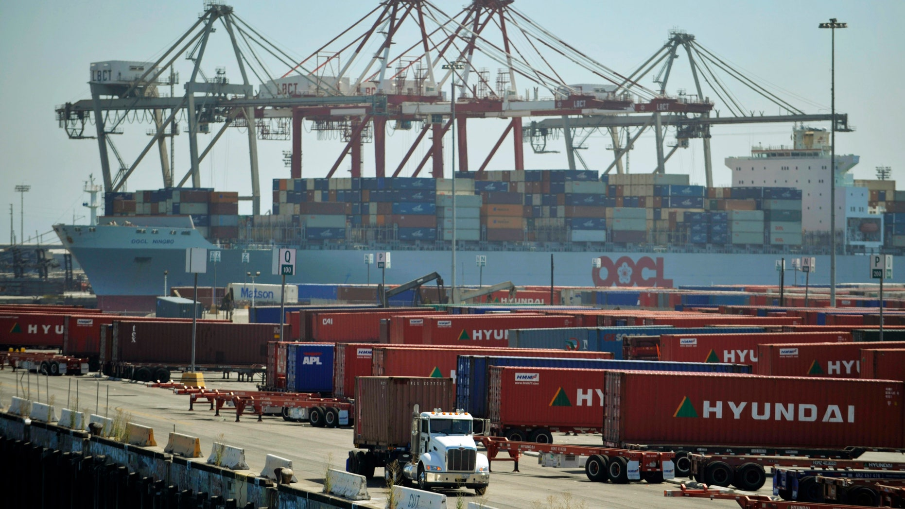 Aug. 24, 2009: A truck passes containers at the Port of Long Beach in Long Beach, Calif.