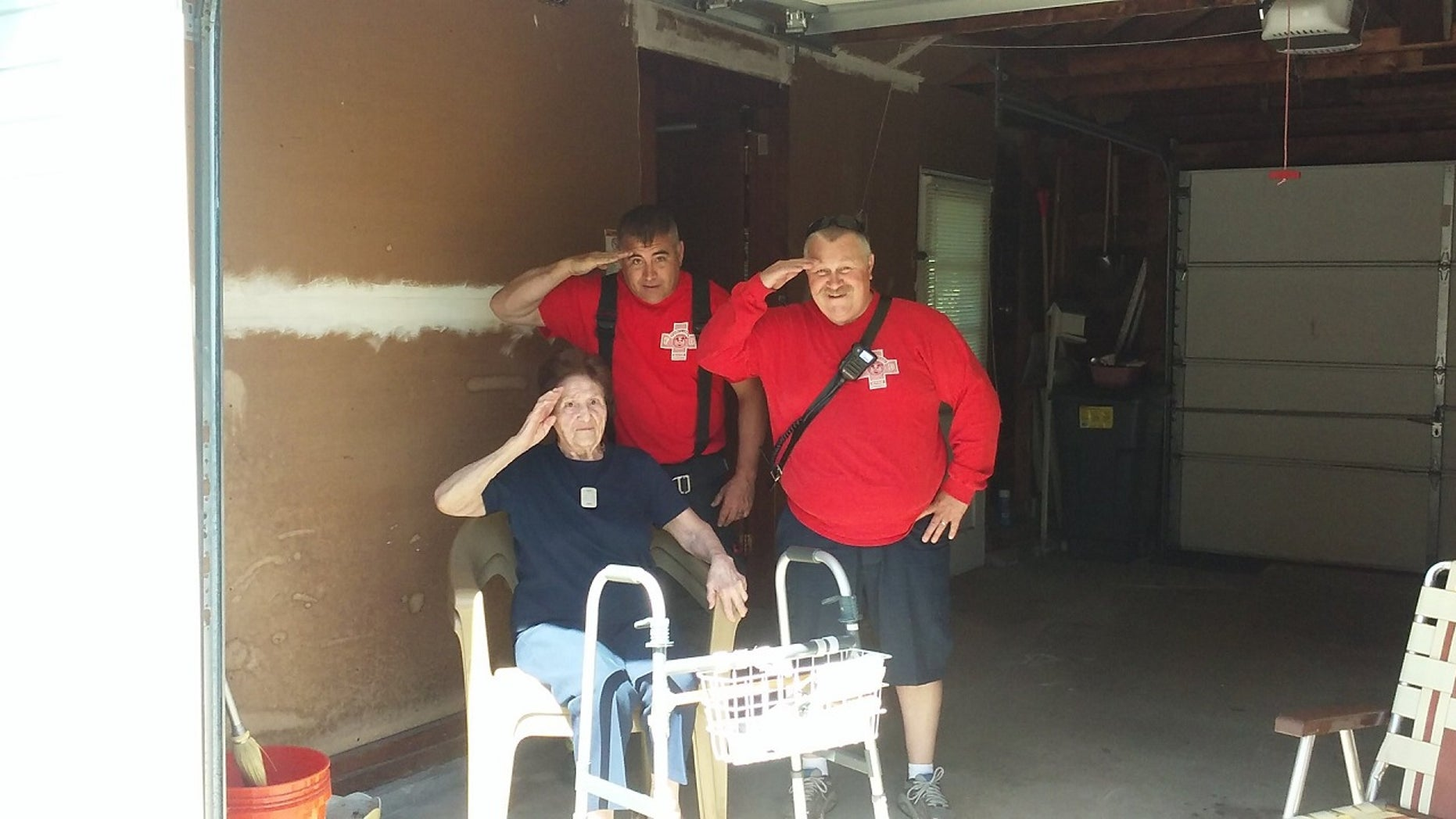 Firefighters in Maine took time on Tuesday to assist a 97-year-old woman with a patriotic task.