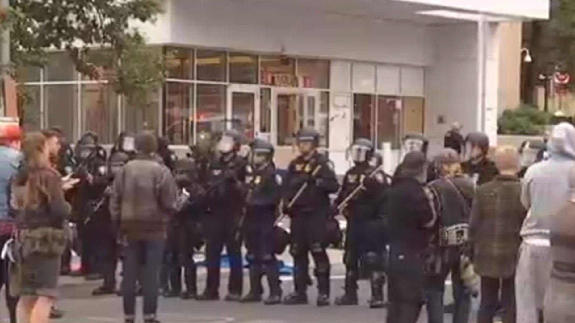 Homeland Security police officers are trying to re-open Thursday an ICE facility in Portland, Ore., that was shut down by protesters.