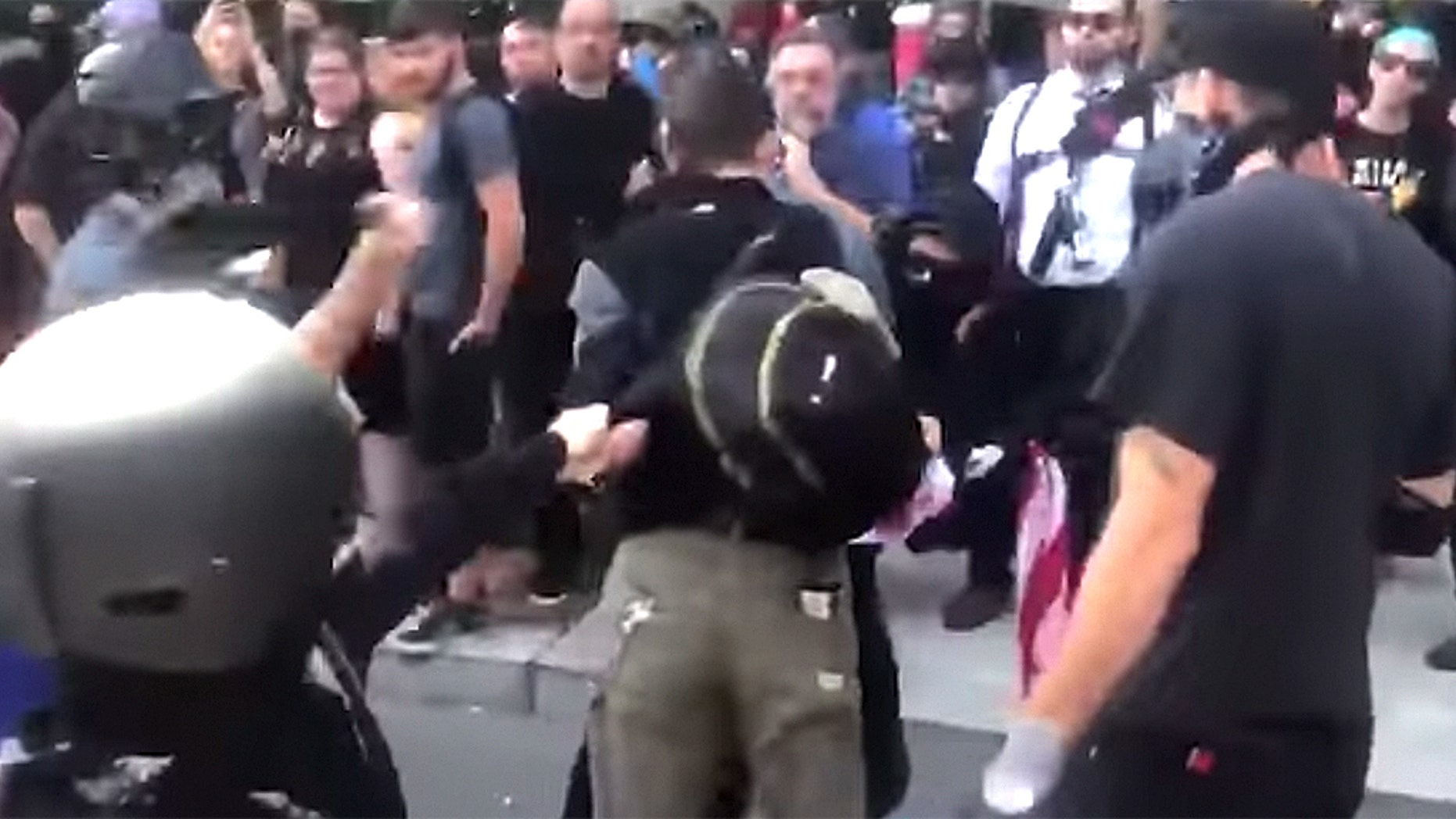Paul Welch was beaten by Antifa members for carrying an American flag at an counter-protest in Portland, Oregon.