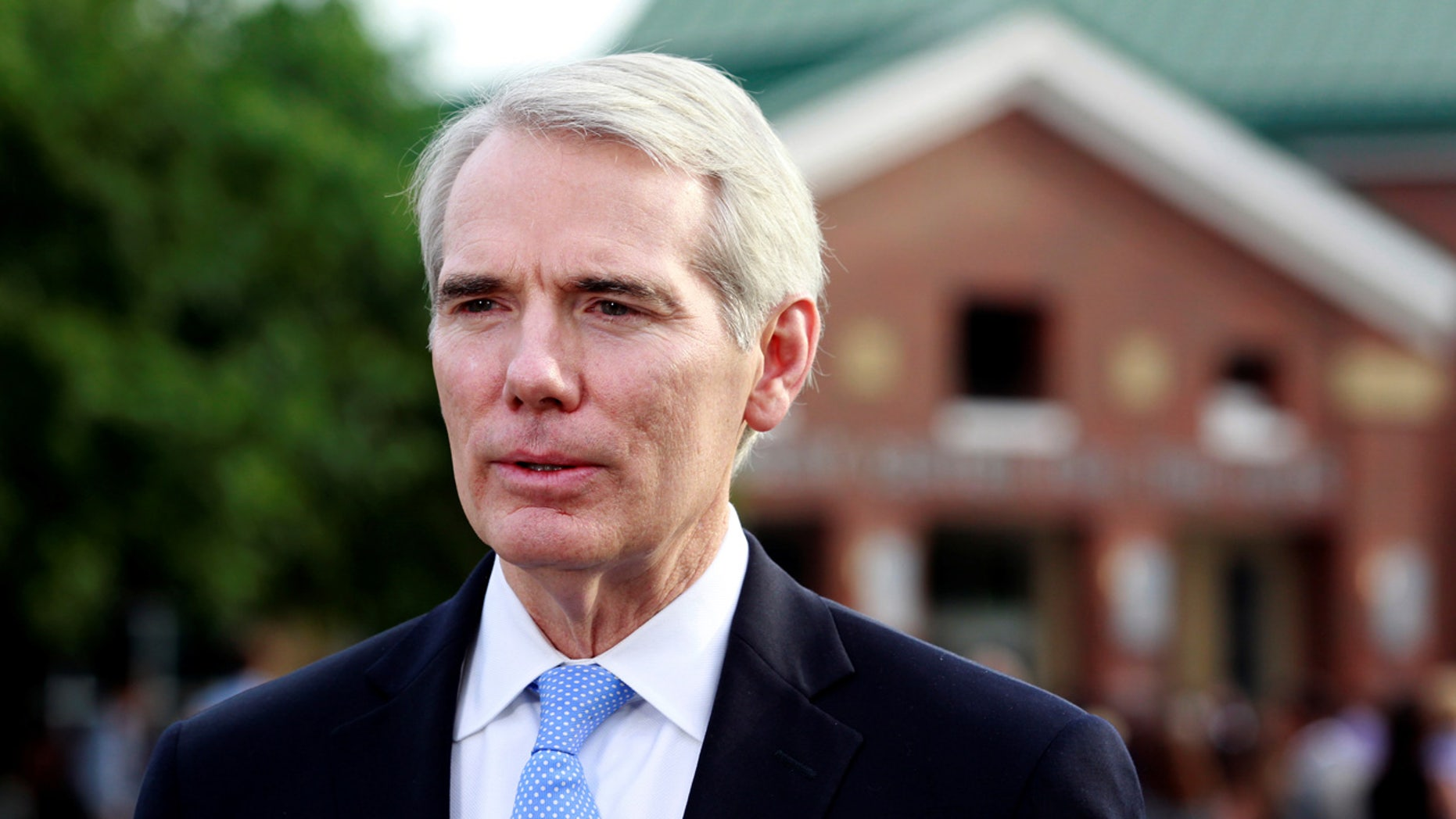 Sen. Rob Portman, R-Ohio, addresses the media outside the art center before a funeral service for Otto Warmbier, who died after his release from North Korea, at Wyoming High School in Wyoming, Ohio, U.S. June 22, 2017.