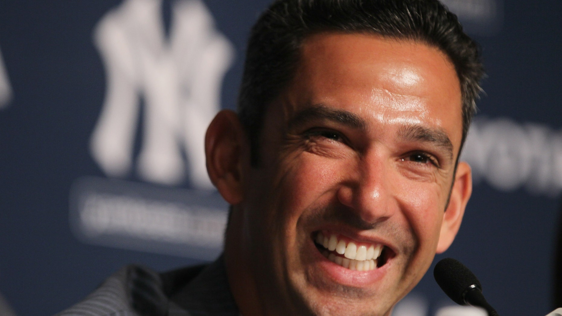 Jorge Posada addresses the media during a press conference to announce his retirement from the New York Yankees at Yankee Stadium on January 24, 2012 in the Bronx borough of  New York City.  (Photo by Mike Stobe/Getty Images)