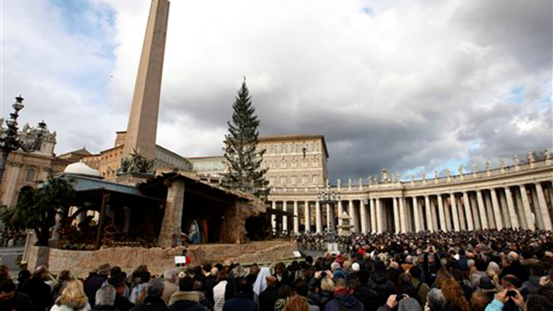 Dec. 26, 2010: People gather in St. Peter's square at the Vatican as Pope Benedict XVI delivers his blessing during the Angelus noon prayer he celebrated from the window of his studio. The pontiff denounced Christmas attacks on the faithful in the Philippines and Nigeria and called for the peaceful resolution of conflicts.