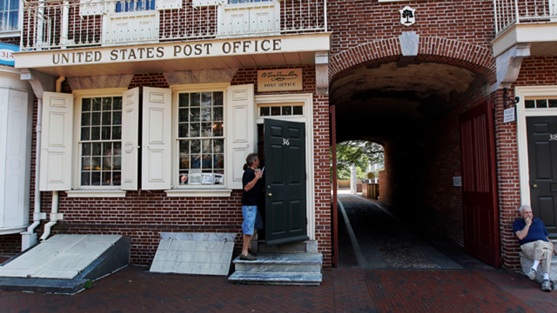 July 26: A man goes in the United States Post Office that predates the American colonies and is on the Postal Service's list of branches that could close.