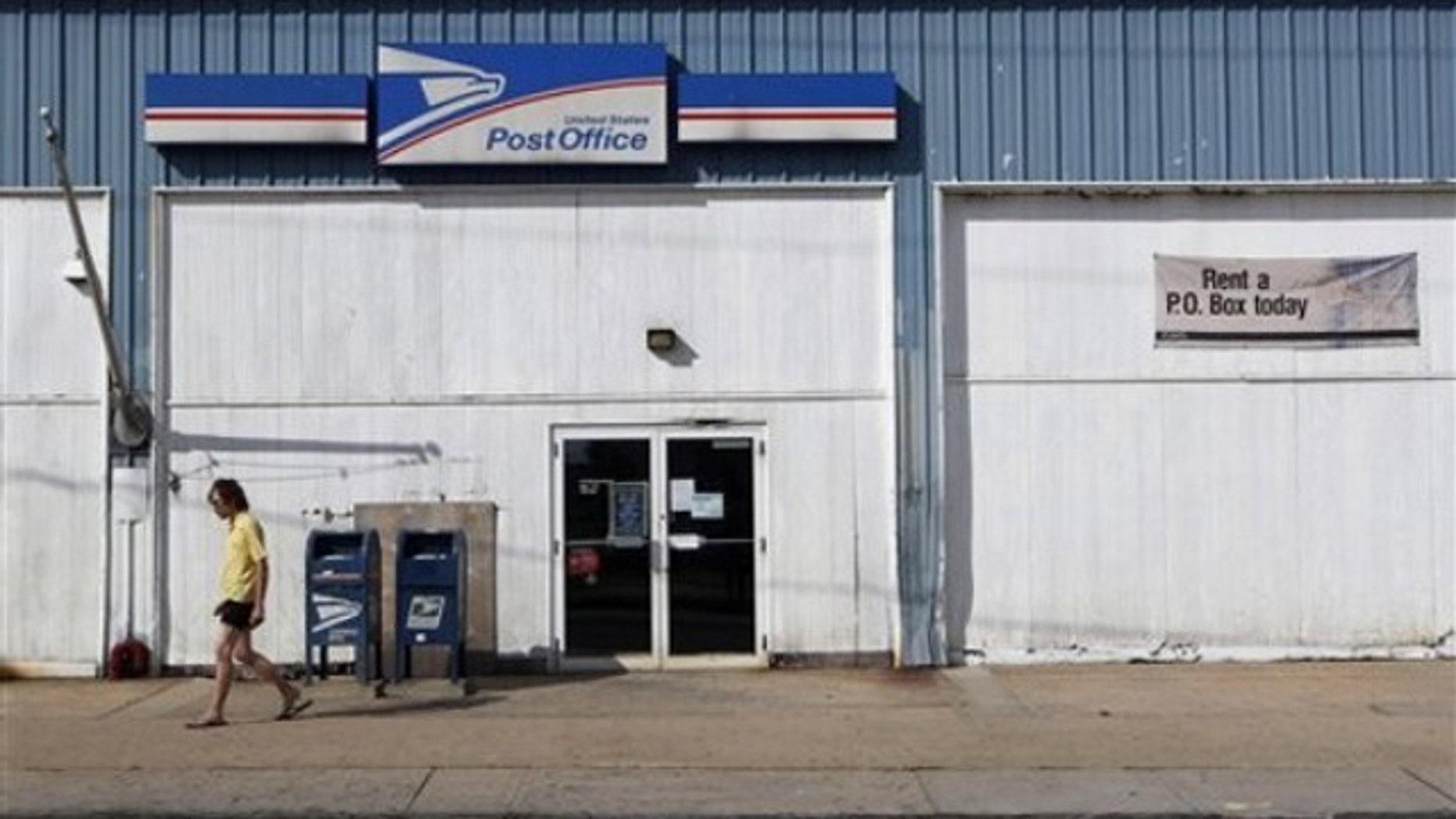 A man walks away from a post office July 27 in New Brunswick, N.J.