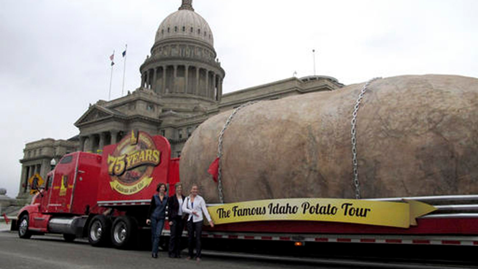 In this March 30, 2012, file photo, the Idaho Potato Commission displays its six-ton tuber replica on the street in front of the Idaho Capitol in Boise.