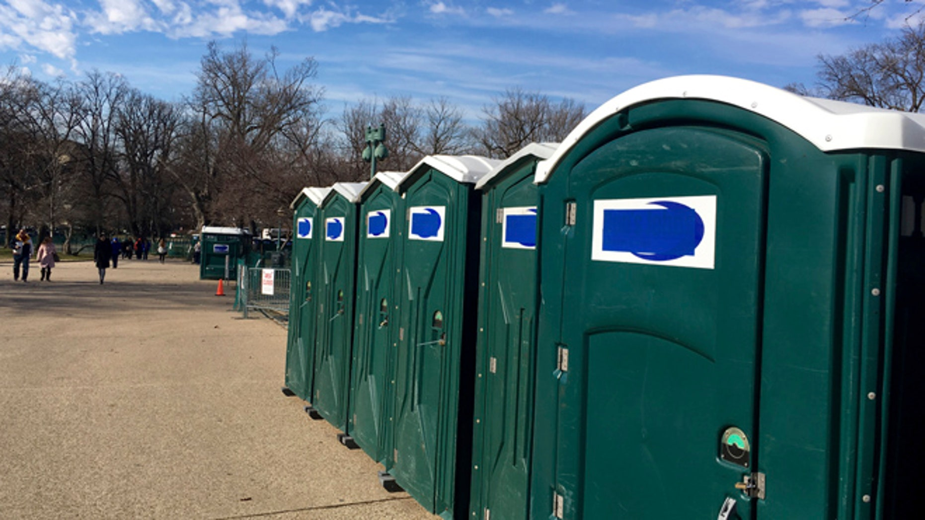 "A row of portable restrooms, with the name ""Don's Johns"" covered up, is seen on Capitol Hill in Washington, Friday, Jan. 13, 2017. Virginia-based Don's Johns calls itself the Washington area's top provider of portable toilet rentals, but the name apparently strikes too close to home for inaugural organizers. Workers have placed blue tape over the brand name on dozens of portable restrooms installed near the Capitol for the inauguration. (AP Photo/Matthew Daly)"