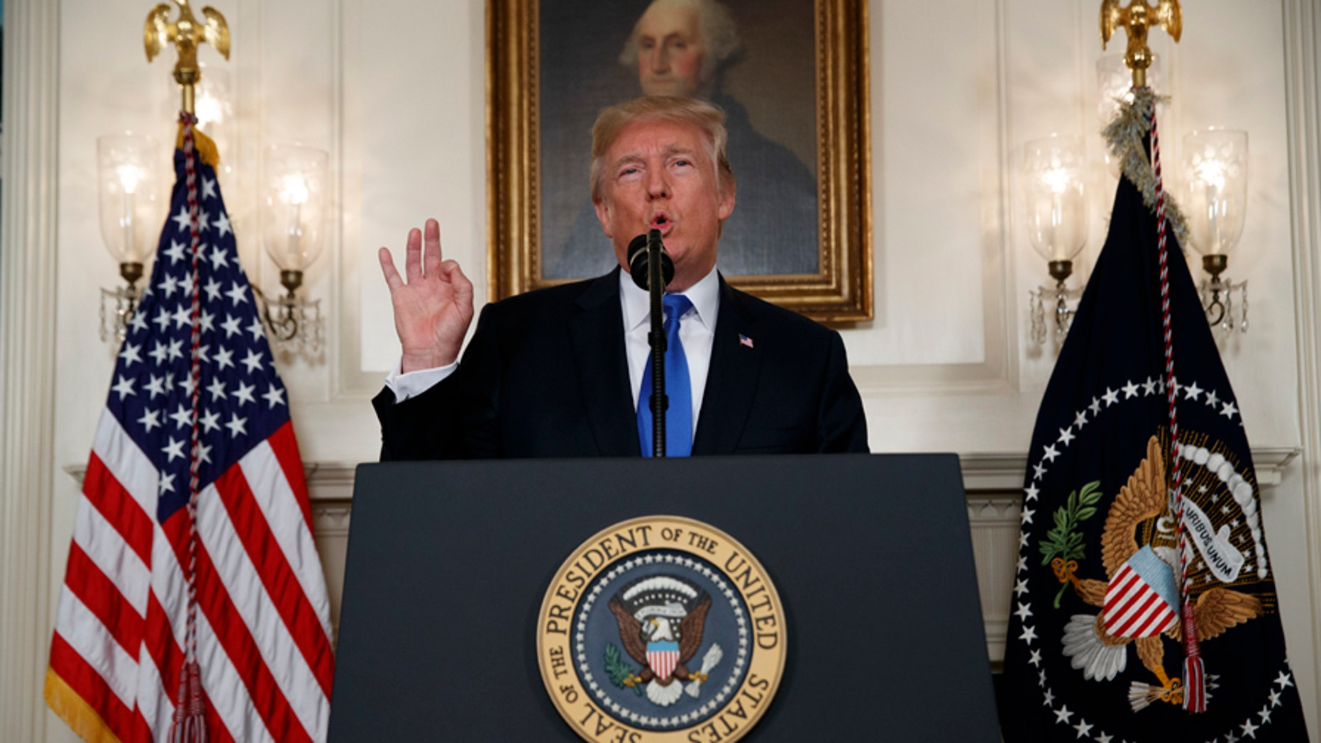 A judge recommended Thursday that President Donald Trump mute rather than block some of his critics from following him on Twitter to resolve a First Amendment lawsuit. ((AP Photo/Evan Vucci)