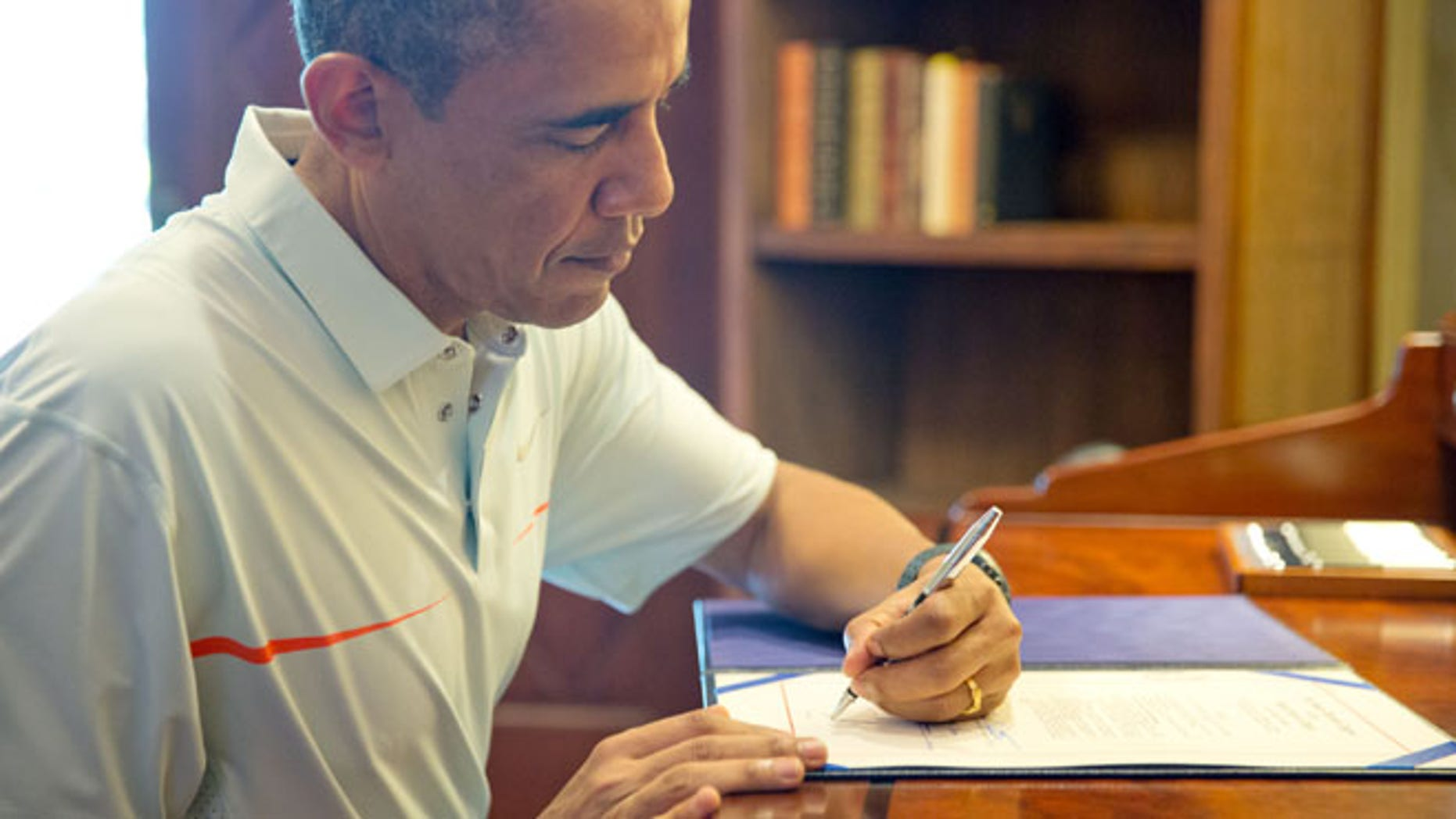 Dec. 26, 2013: President Barack Obama signs bills in Kailua, Hawaii.(Official White House Photo by Pete Souza)
