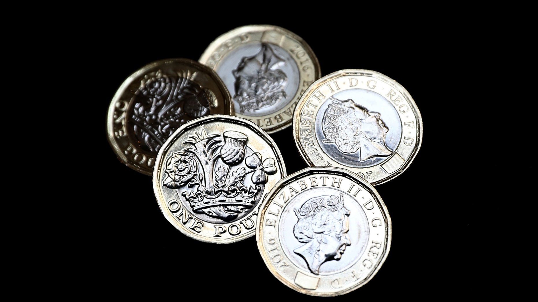File photo - New one pound coins, which come into circulation today, are seen in London, Britain March 28, 2017 (REUTERS/Neil Hall).