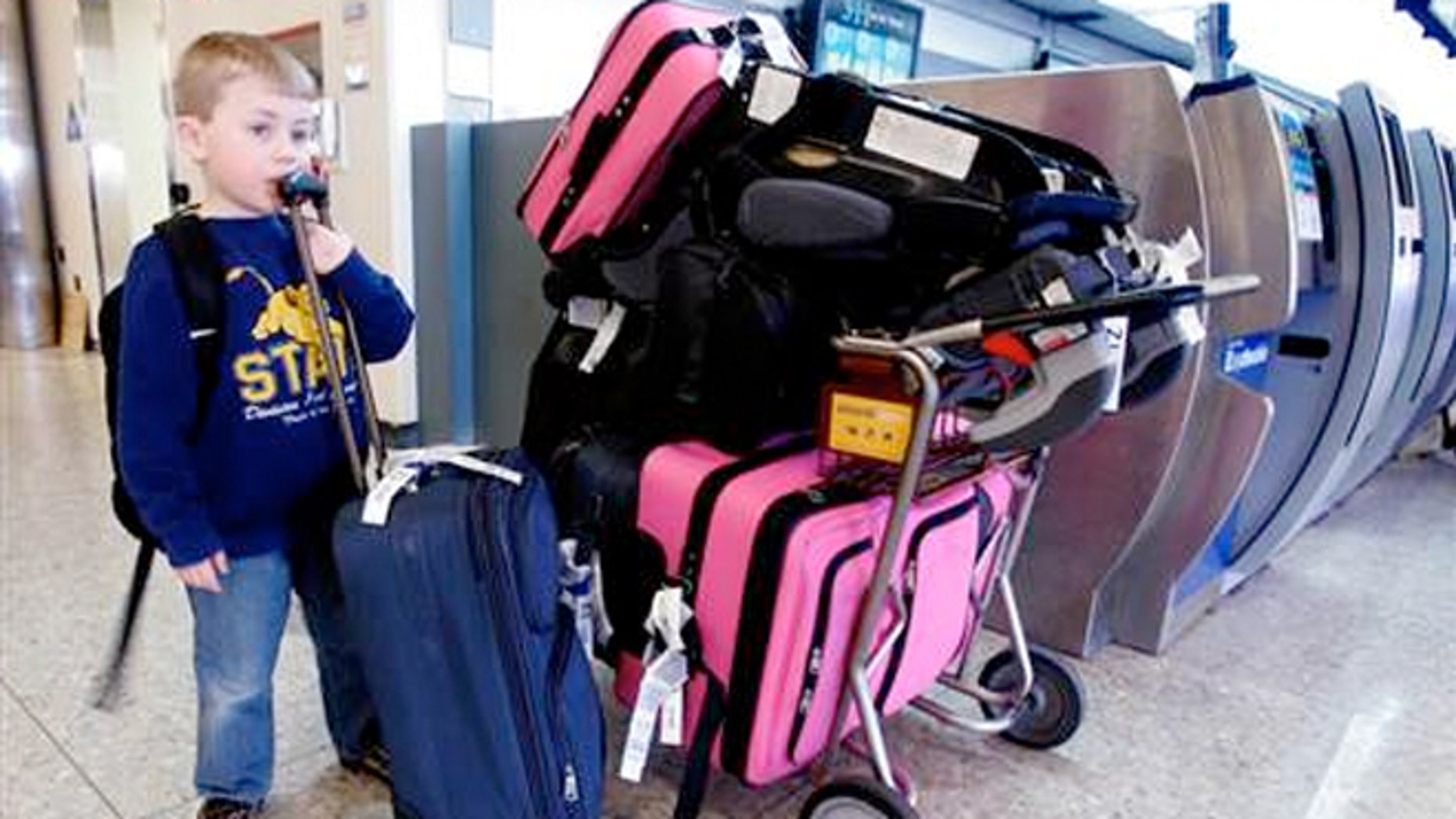 Zachary Cunningham, 5, waits after his family's ATA Arilines flight for his two week vacation to Hawaii.