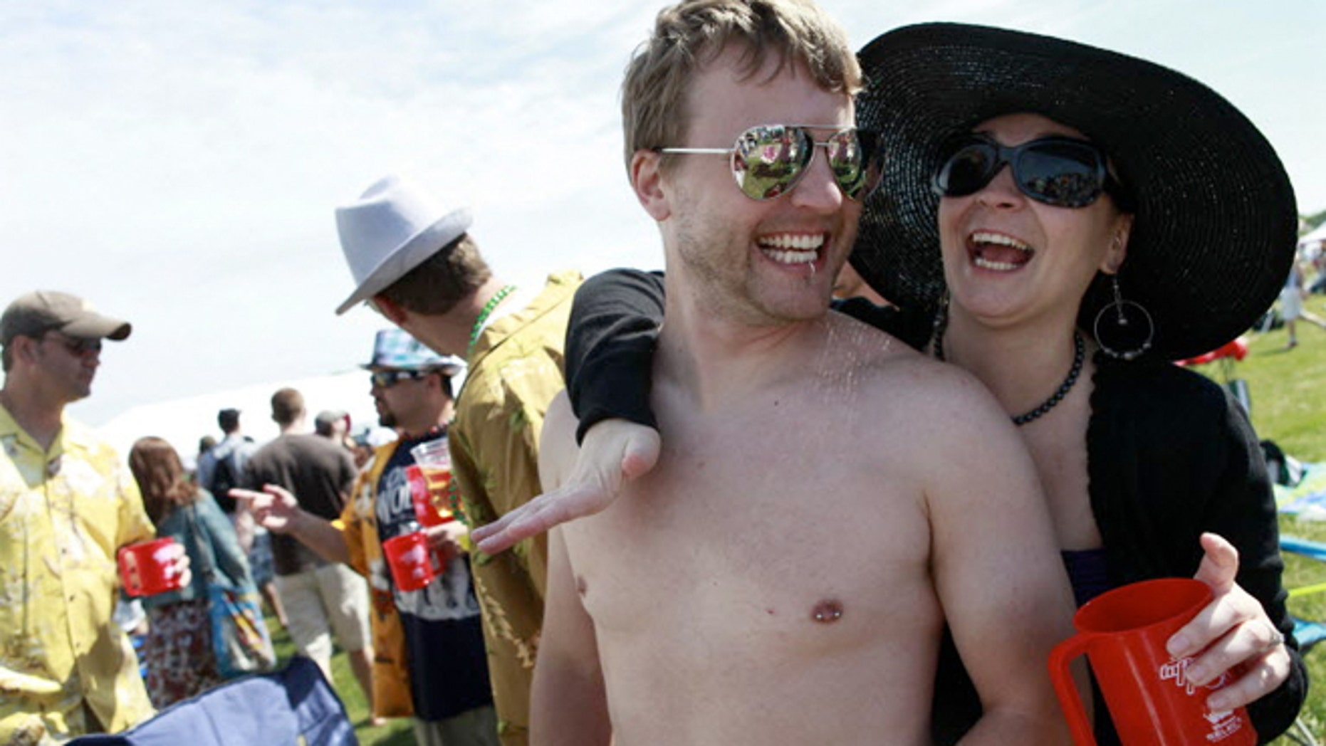 Parties on the in-field are the main attraction for some at Pimlico Race Course, like these two the 135th Preakness Stakes.