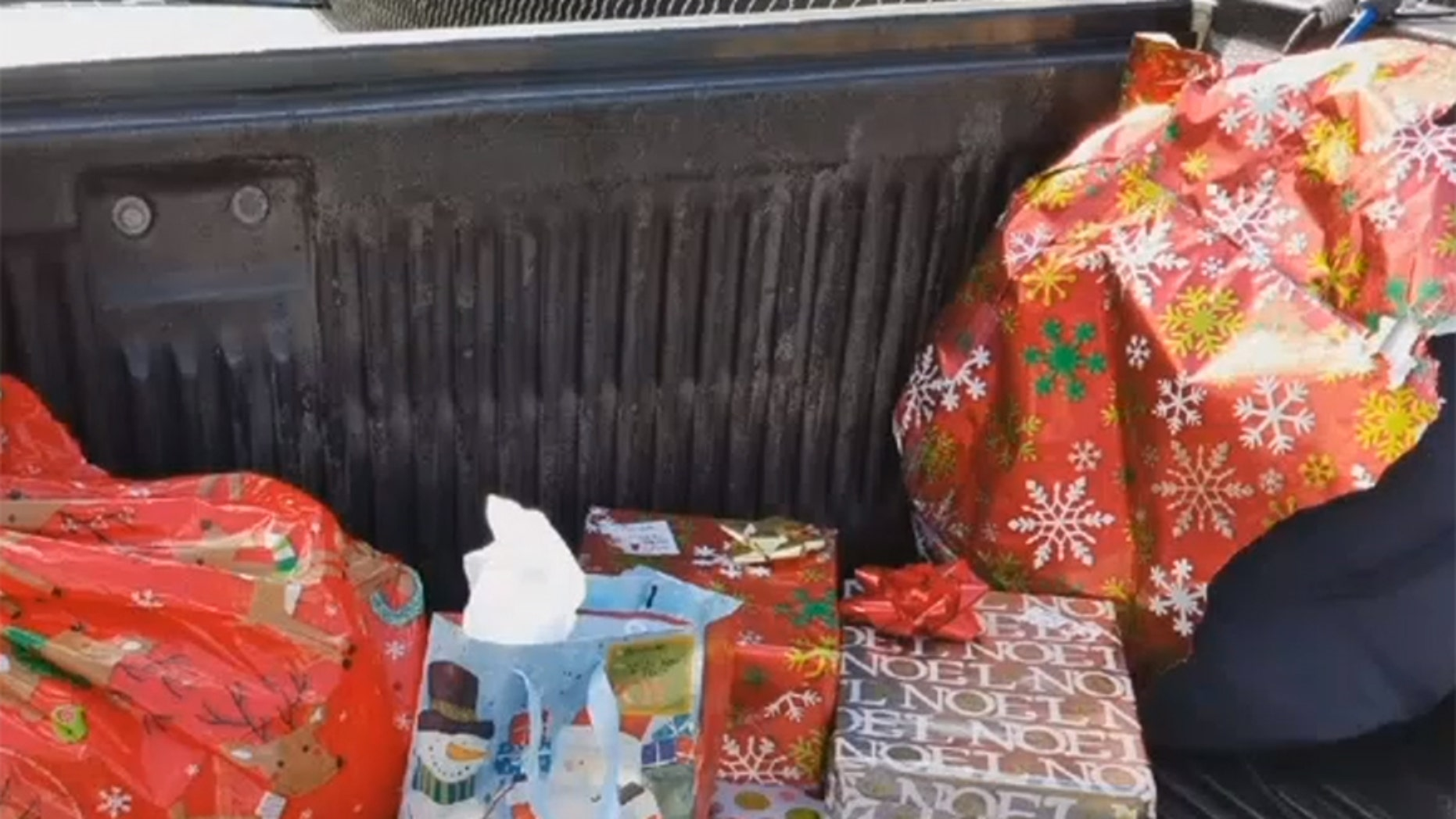 A woman spotted Christmas presents on the side of a Florida highway and wants to return them to the owner.