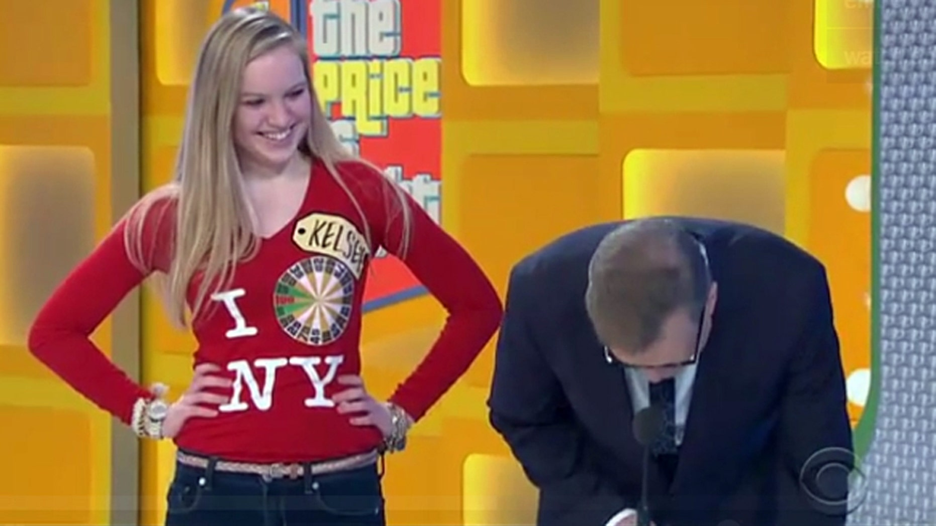"""""""The Price is Right"""" host Drew Carey doubles over in laughter after New York City contestant Kelsey answers his question."""