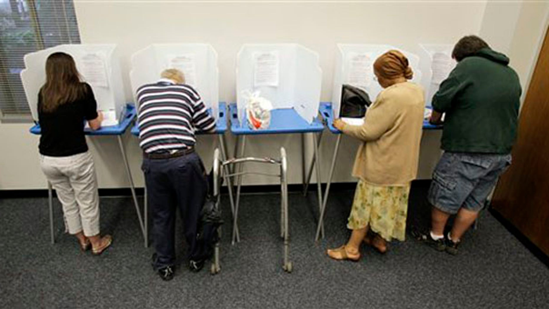 Voters cast their ballots during early voting for the Indiana primary election in Indianapolis May 3. (AP Photo)