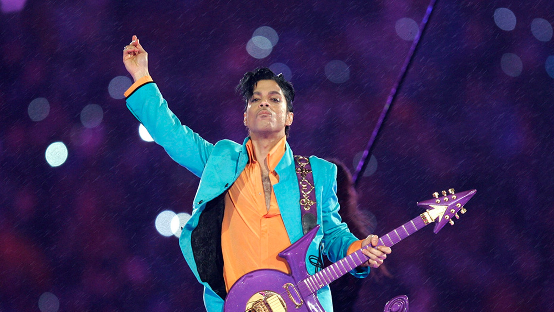 FILE - In this Feb. 4, 2007, file photo, Prince performs during the halftime show at the Super Bowl XLI football game at Dolphin Stadium in Miami. Thousands of Prince fans have signed a petition asking federal authorities to open a grand jury investigation into his 2016 death. (AP Photo/Chris O'Meara, File)