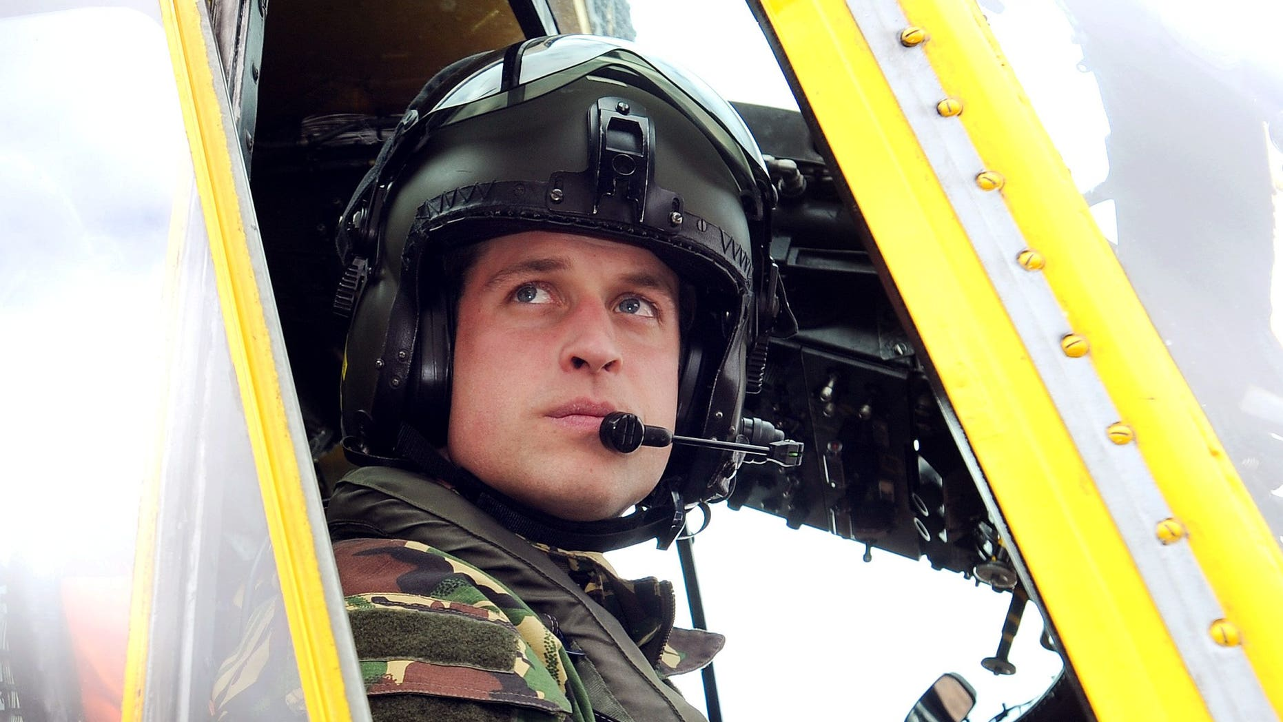 March 31, 2011. Prince William sits at the controls of a Sea King helicopter during a training exercise at Holyhead Mountain, in Wales.