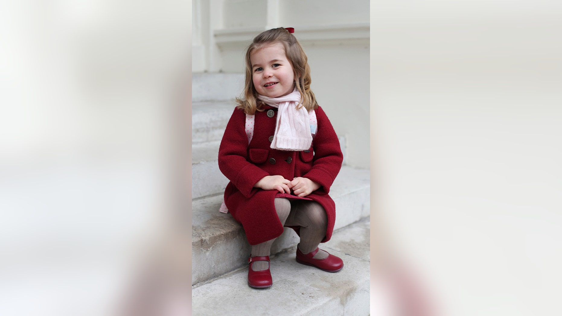 The youngest royal, Princess Charlotte, smiles as she prepares to attend her first day of school at the Willcocks Nursery School, in London, Monday, Jan. 8, 2018.