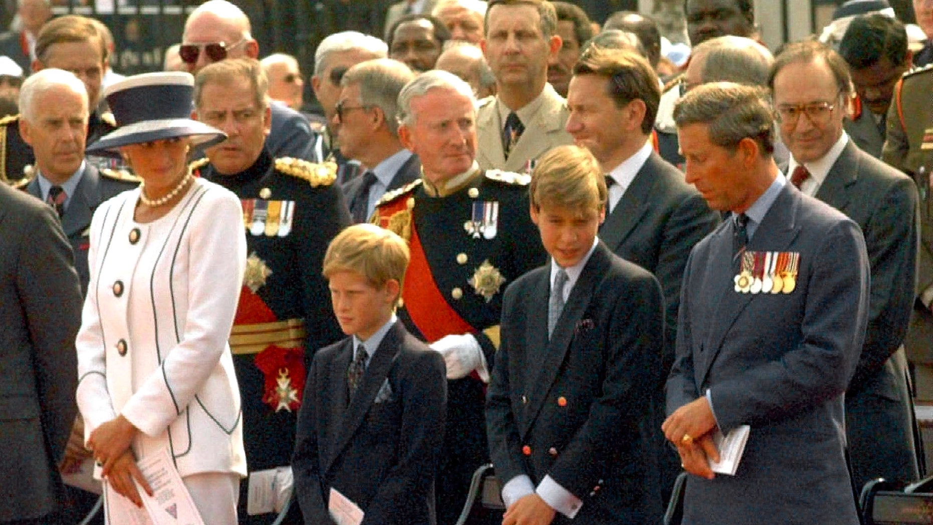 File photo -  Princess Diana and Prince Charles, with their sons Prince Harry (L) and Prince William, stand outside Buckingham Palace August 19, 1995 during Britain's VJ (Victory over Japan) Day commemoration service (Reuters).