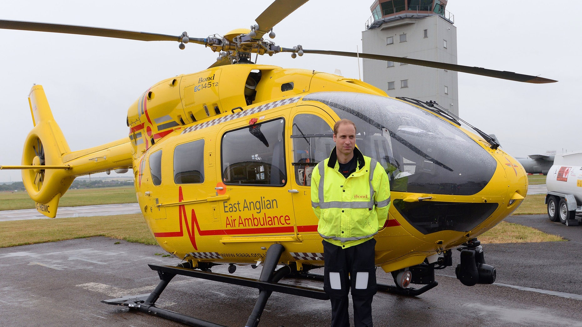 File photo - Britain's Prince William poses by his helicopter as he begins his new job as a co-pilot with the East Anglian Air Ambulance (EAAA) at Cambridge Airport, Britain July 13, 2015. (REUTERS/Stefan Rousseau/pool)