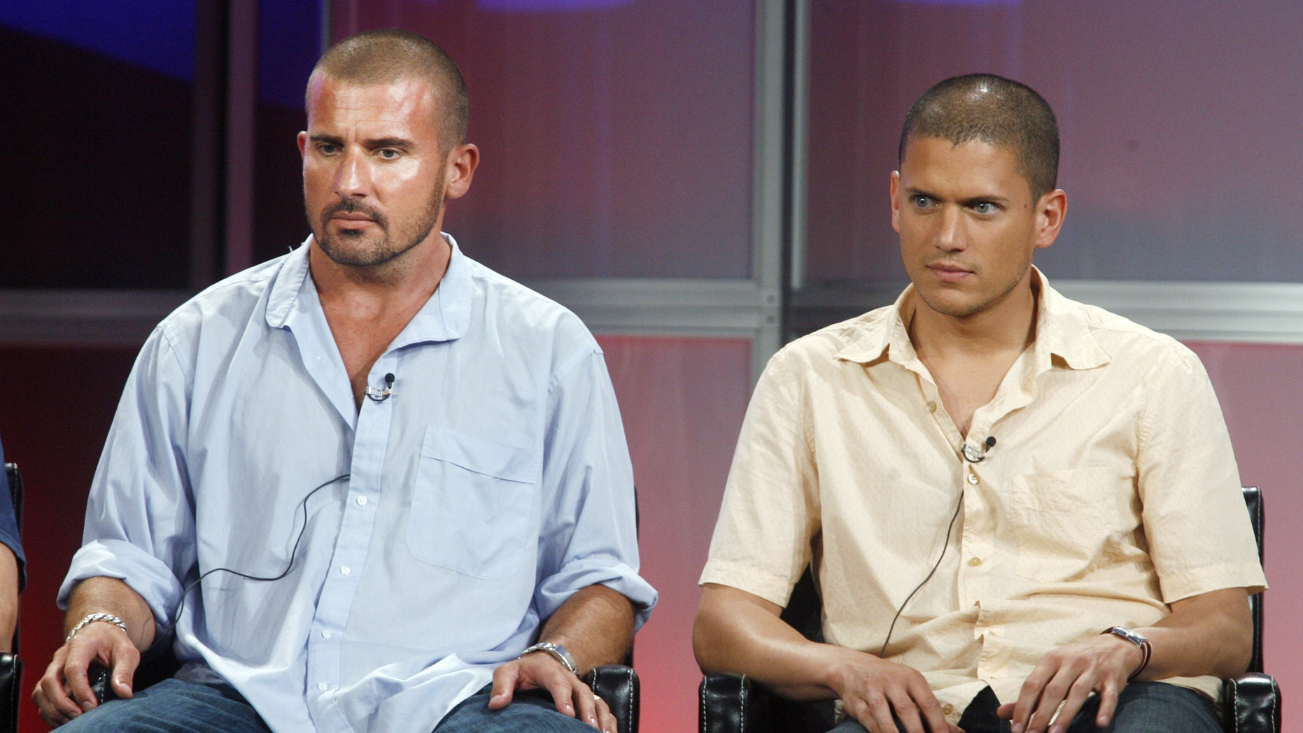 Actors Dominic Purcell (L) and Wentworth Miller, stars of the Fox television network drama series 'Prison Break,' about a group of escaped prisoners, answers questions during a panel discussion at the Television Critics Association summer media tour in Pasadena, California July 24, 2006. The show premieres Fall 2006. REUTERS/Fred Prouser (UNITED STATES) - RTR1FSNW